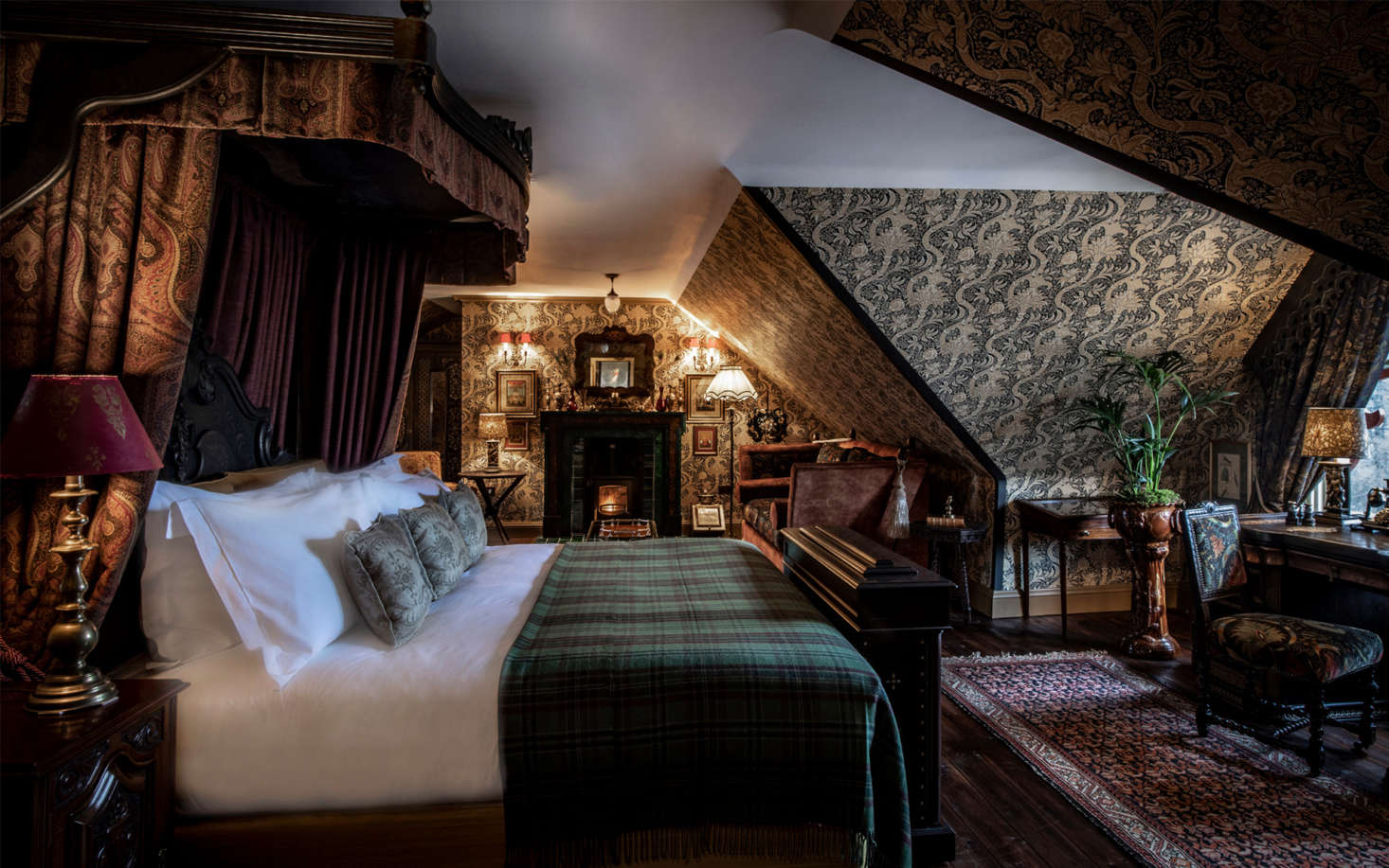 Another royal suite, done floor-to-ceiling in patterned wallpaper, with the requisite tartan blanket.