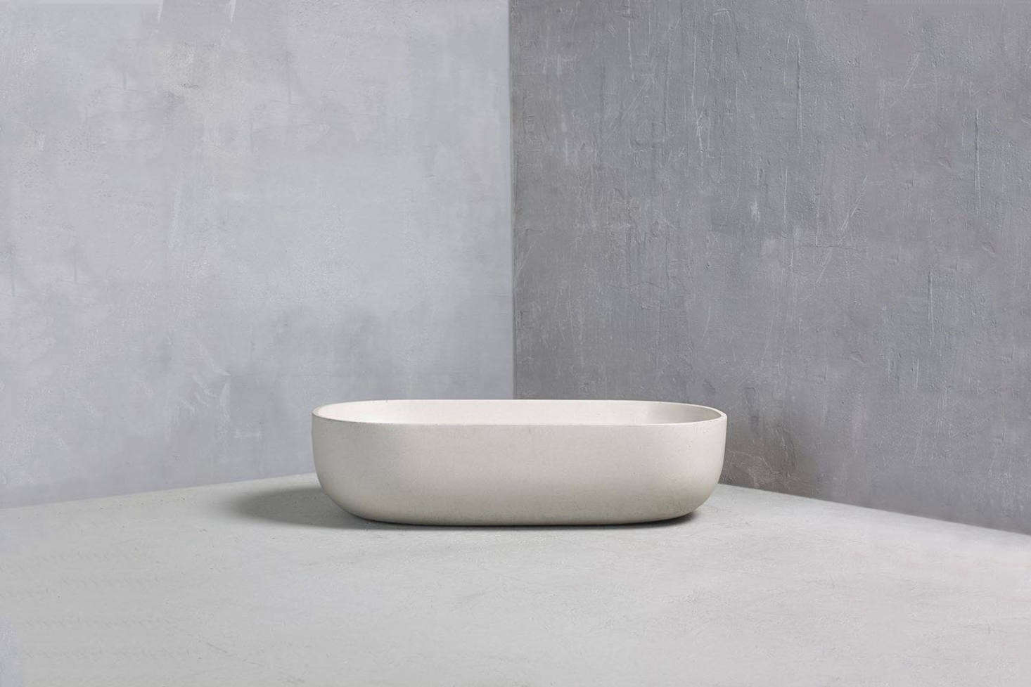 The antique stone wash basin in the bathroom is one-of-a-kind sourced by Chan & Eayrs. For a similar shape, the Bert & May Rho Basin made in collaboration with British maker Kast out of colored concrete basin—shown in Limestone; £src=
