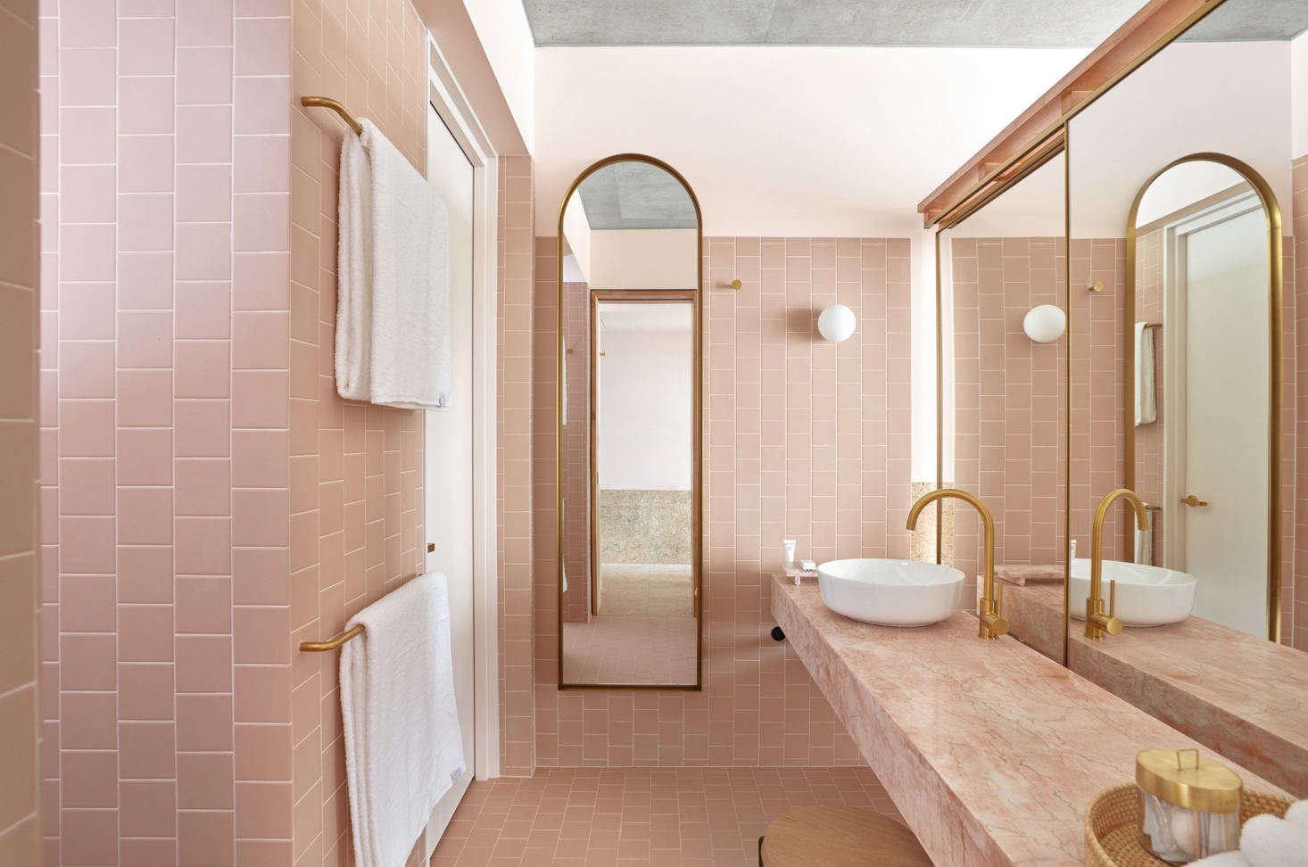 Tiled pink walls and a floating vanity of pink marble at the Richards and Spence-designedCalile Hotel in Brisbane, Australia.