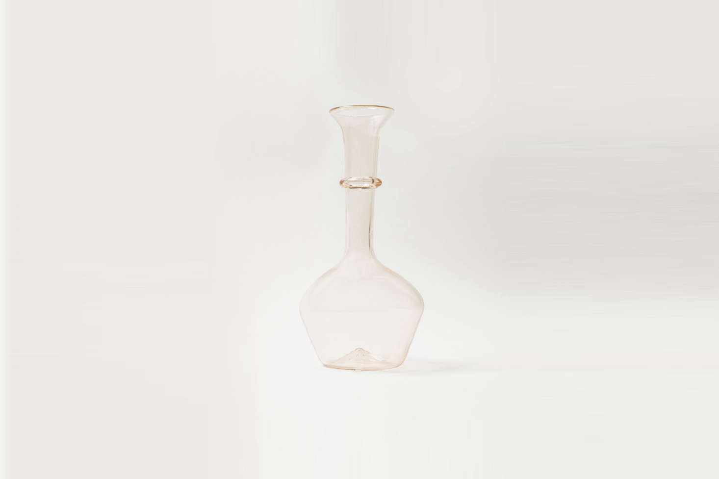 Annie would be over the moon to receive this unusually shaped Pienza Graduated Decanter, in the prettiest transparent pink, from Il Buco; $9.