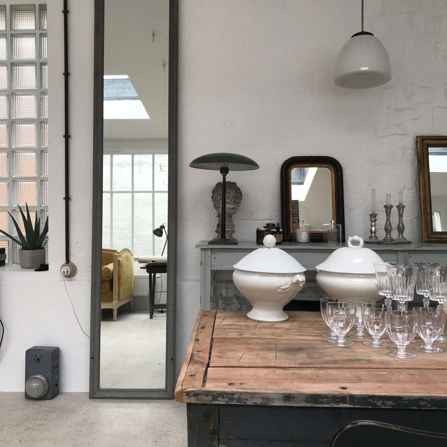 Another favorite in Reims: Brice Bérard Antiques and Les Pénates Reims, with mirrors, furniture, and vintage lighting sourced by partners Brice Bérard and designer Annabelle Brun. (&#8