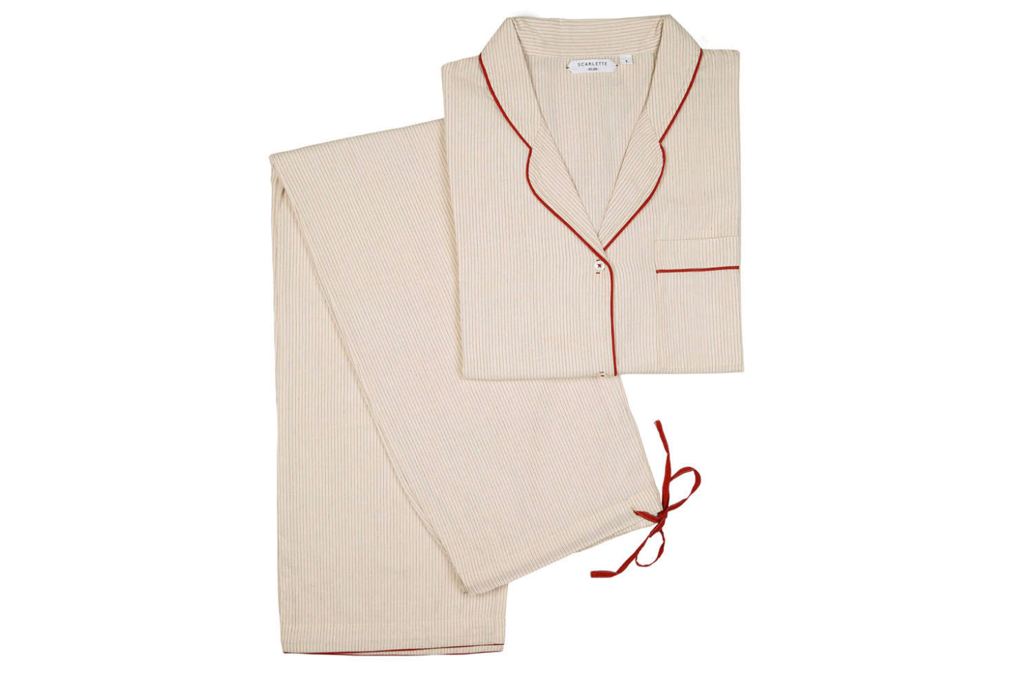 Margot is enamored of this cotton Pajama Set with a subtle stripe and crisp red border, from French brand Scarlette Ateliers; €0.