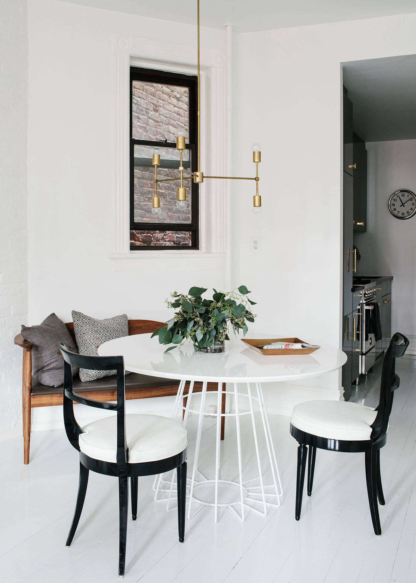 The dining niche, in one corner of the living room, features the Compass Dining Table from CB
