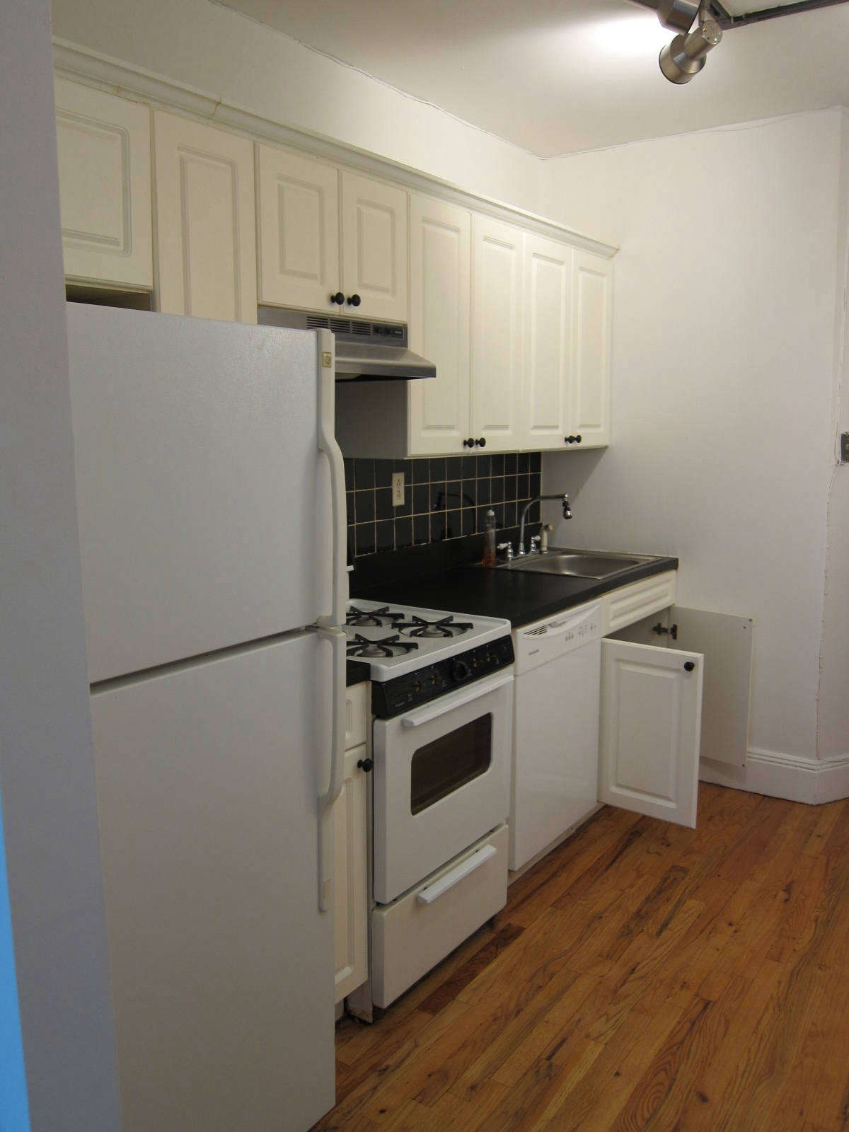 The dated galley kitchen, before.