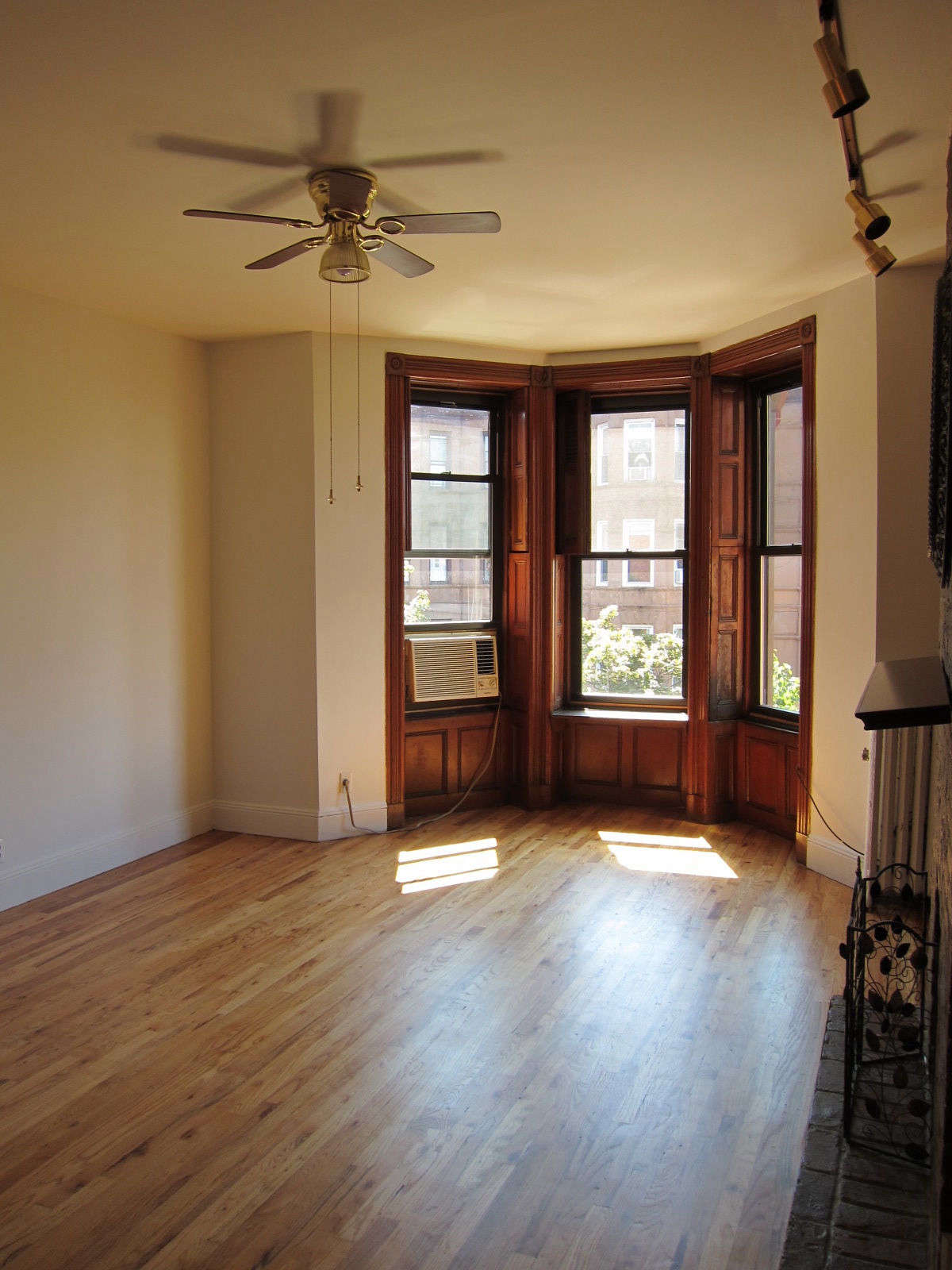 Before, the apartment was an ode to the '80s, with track lighting, ceiling fans, and yellow oak floors.