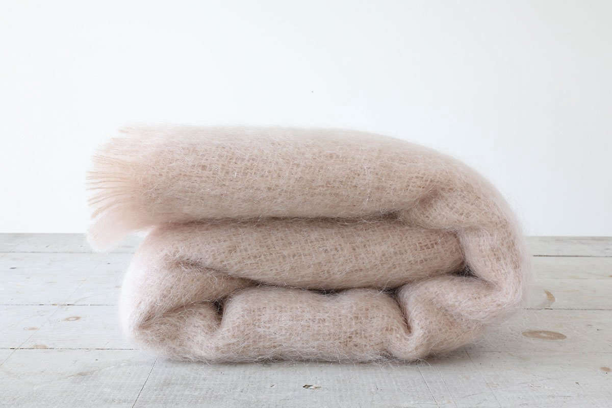 Justine is eying this Rose Mohair Throw, woven in the U.K., because &#8