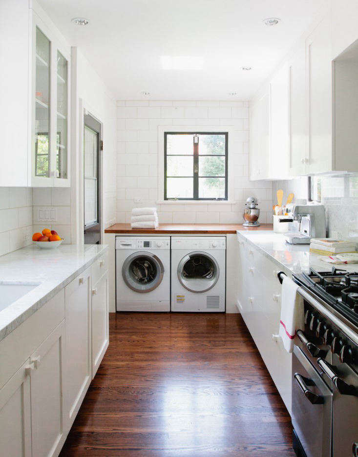 No laundry room? No problem. Check out 7 Ways to Sneak a Washer/Dryer Into the Kitchen for some inspiring solutions to a small-space conundrum. Photograph by Jessica Comingore.