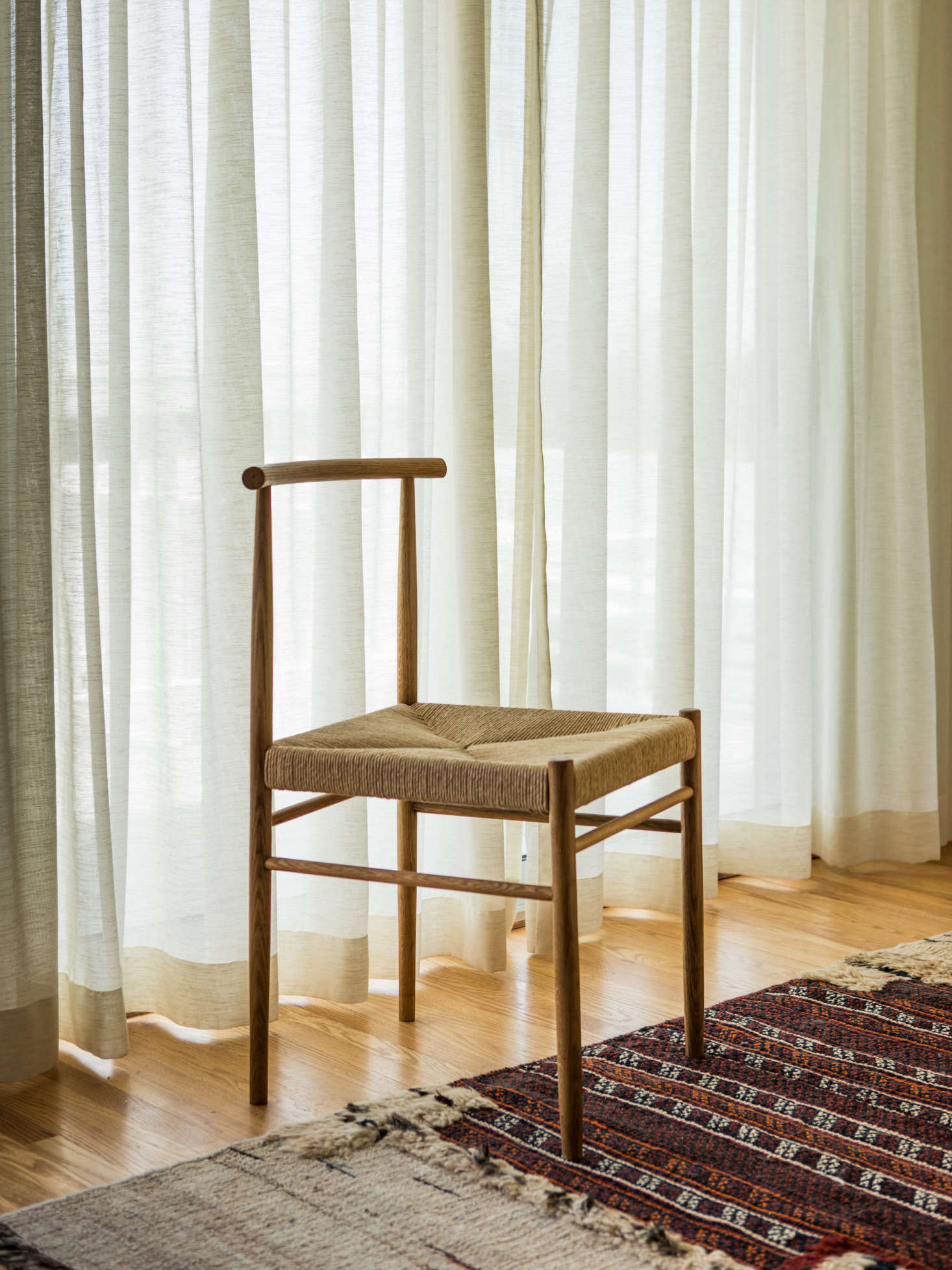 The 02 Chair by EB Joinery is made with traditional joinery and has a woven rush seat; $2,450.