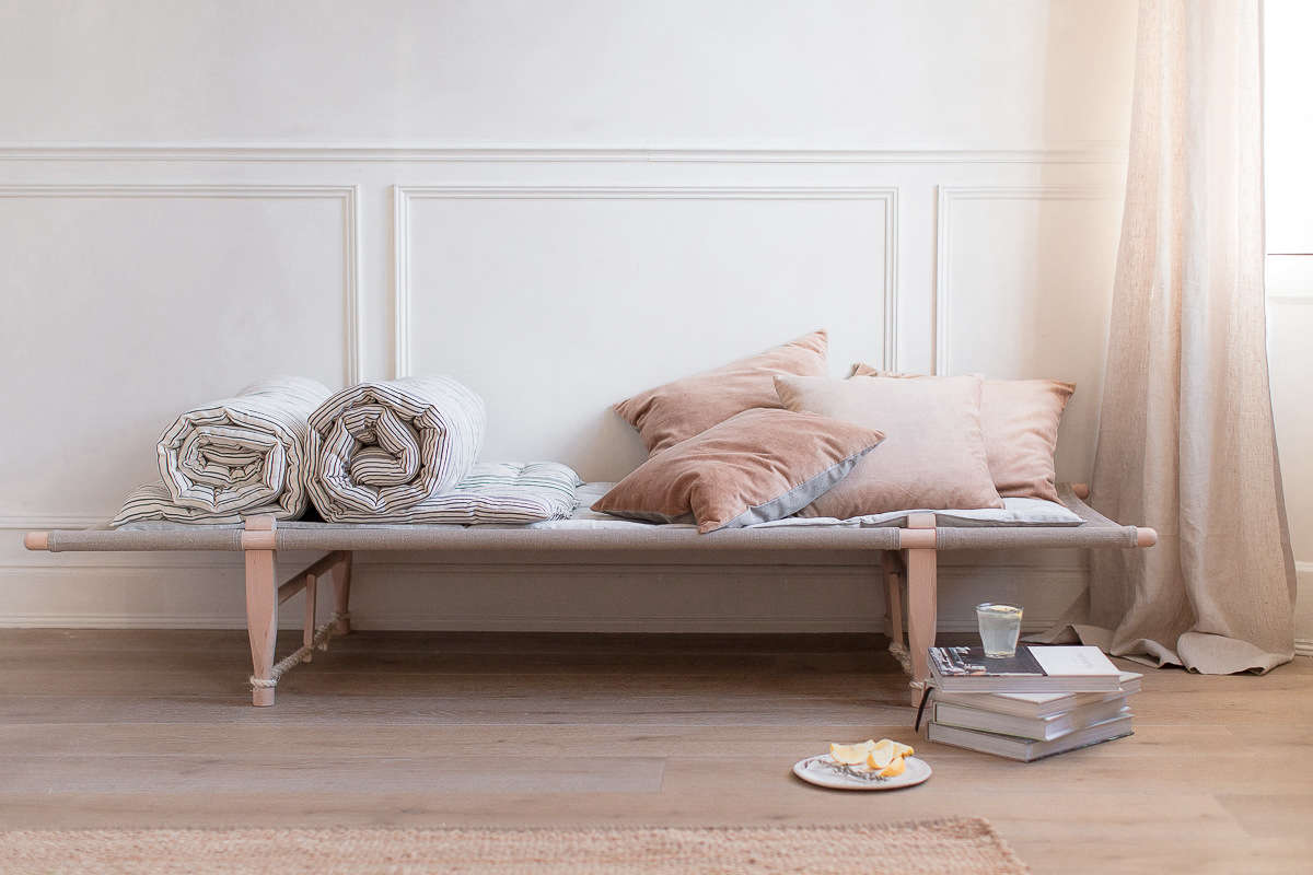 Kapok bedrolls and Kirsten Hecktermann pillows on theOGK Safari Daybed, designed in 6