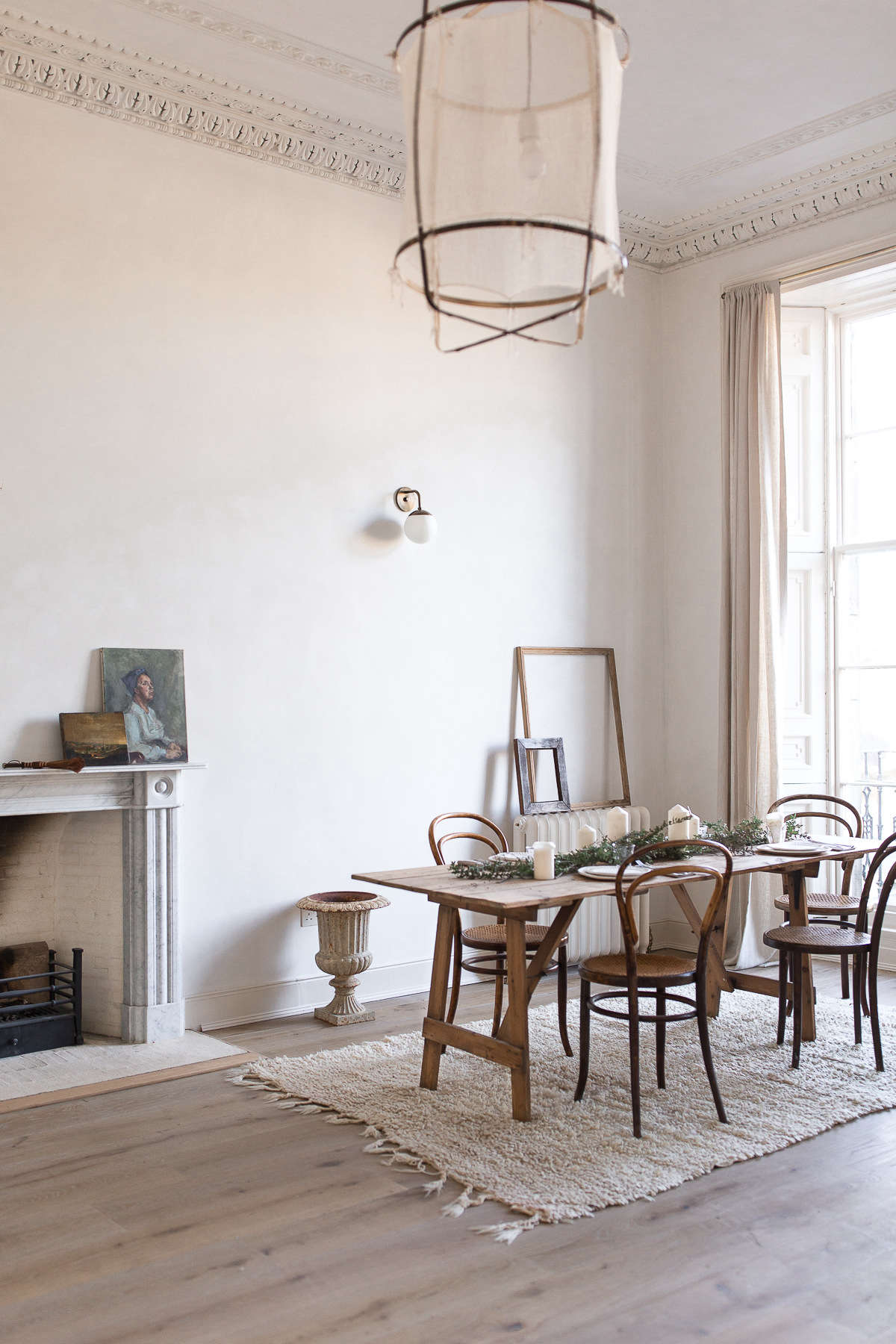 The same corner becomes the dining area when Nina and Craig are expecting friends for a meal—or Nina is shooting tabletop items. The set of antique bentwood chairs were purchased for &#8