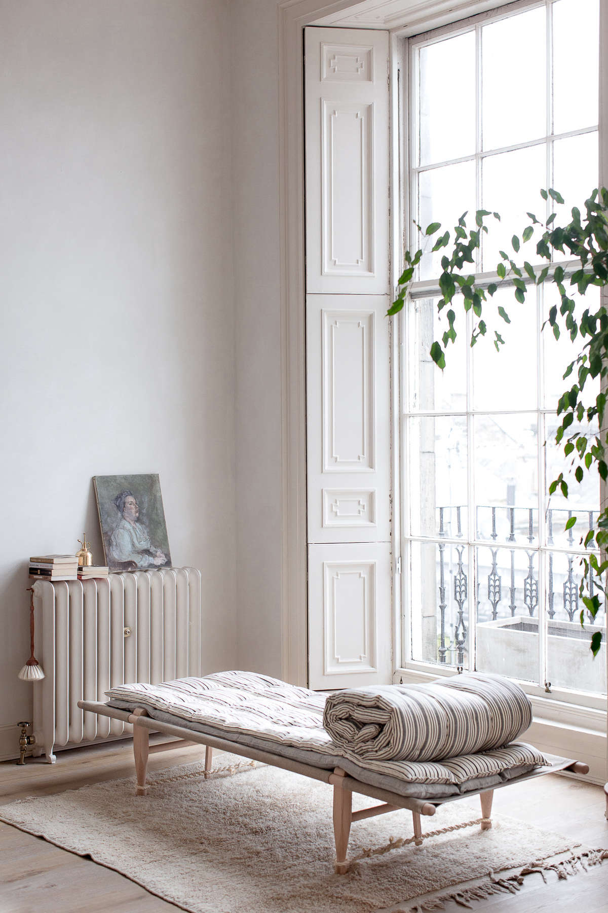 In the 60s, the townhouse was divided into four apartments. Theirs came with many original features intact but in need of care and restoration: an enormous number of details went into making the space look the way it does now. For instance, the windows were &#8