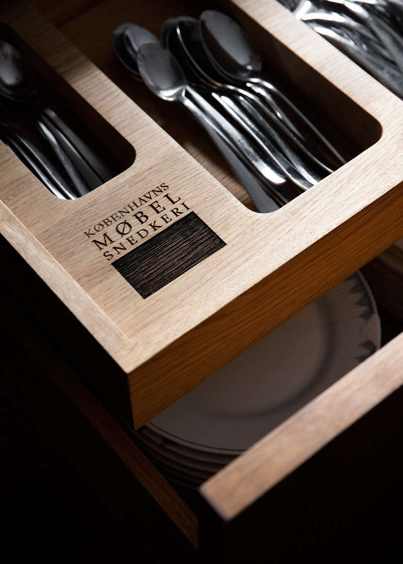 Custom cutlery drawers are one of KBH Københavns Møbelsnedkeri's signature touches.