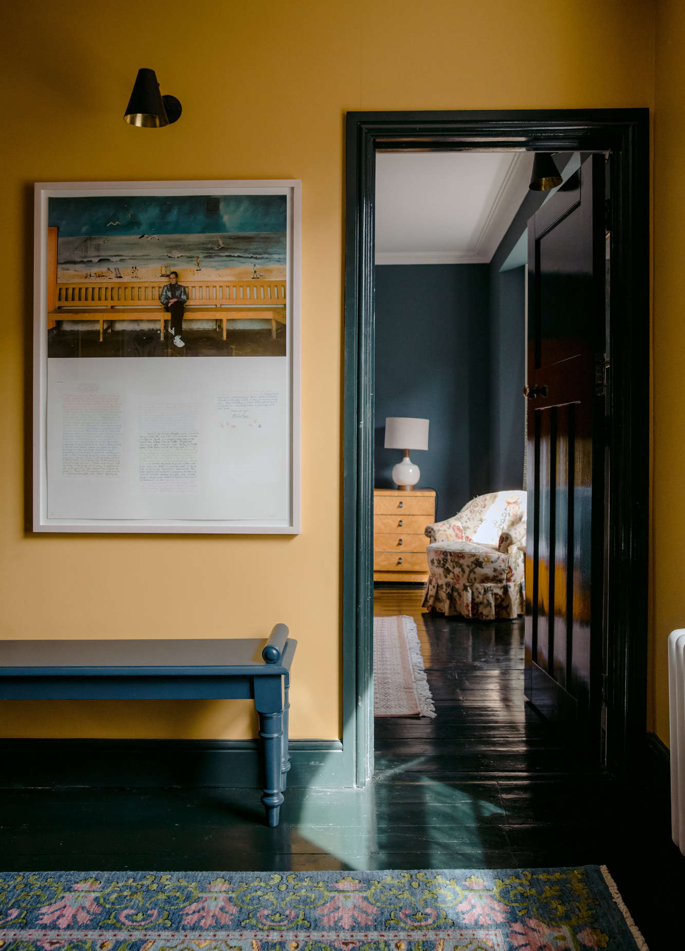 Black-painted wood floors in an English hotel; see more in The Rose: A Singular Seaside Inn on the English Coast, Color Edition.