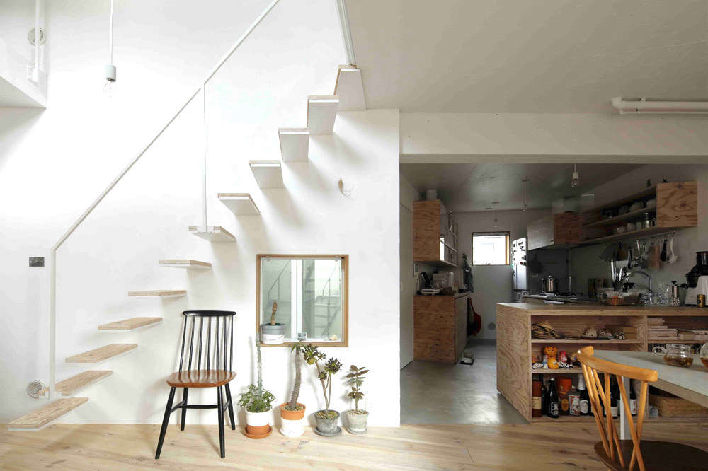 The floating design has pine-topped steel treads and a minimalist steel railing. Suffice it to say building codes are far less strict in Japan than they are in the US.