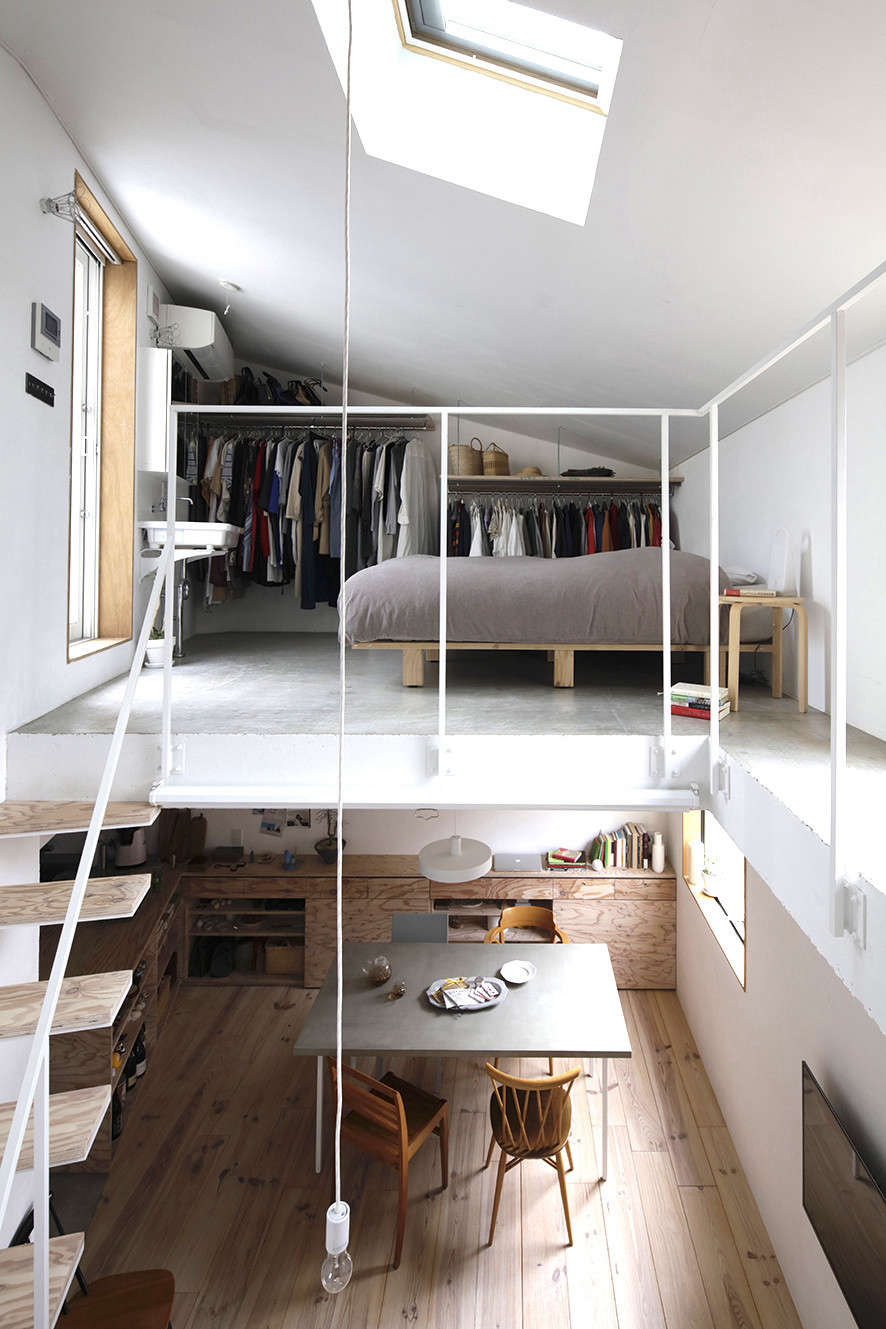 Edged by only a hint of railing, the master bedroom has open closets and a sink. It&#8
