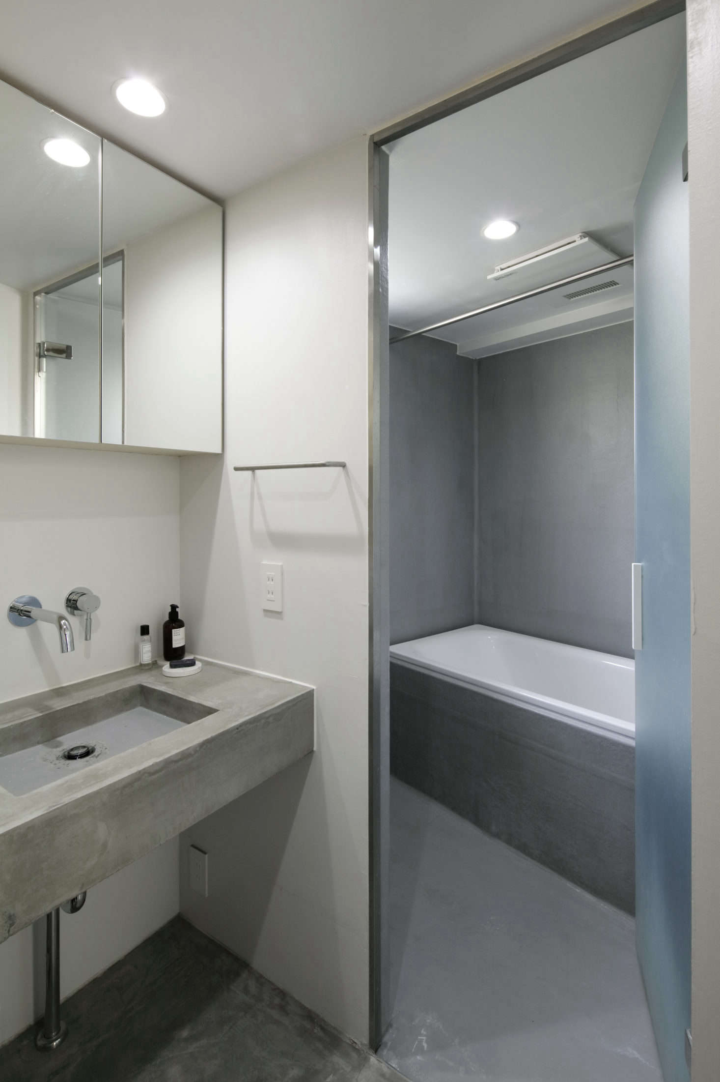 The master bath is a study in concrete.