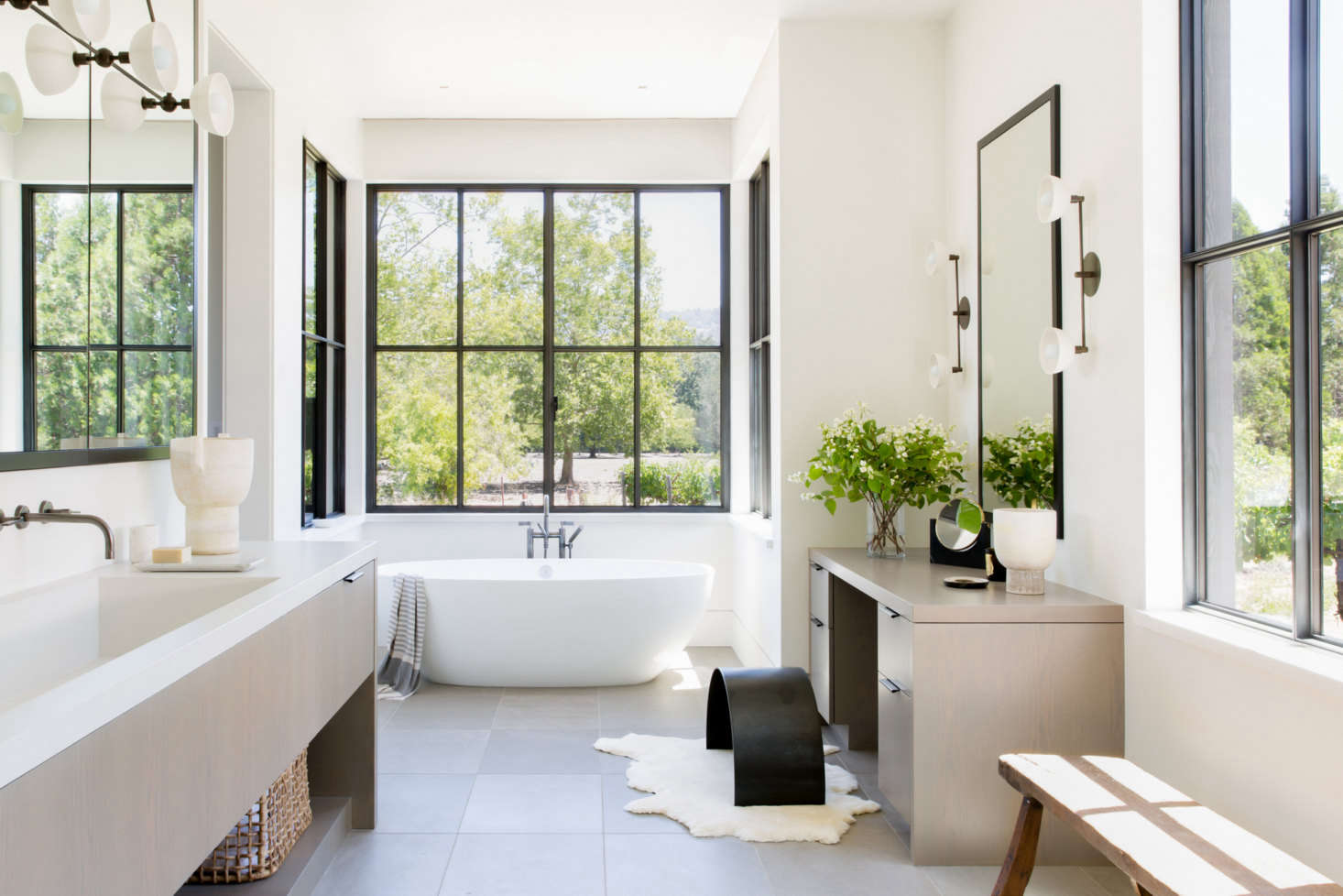 """The bright master bedroom is anchored by a Victoria & Albert Barcelona Soaking Tub. """"It'smy favorite room in the house,"""" Geremia says. """"It's focused on ritual and relaxation."""""""