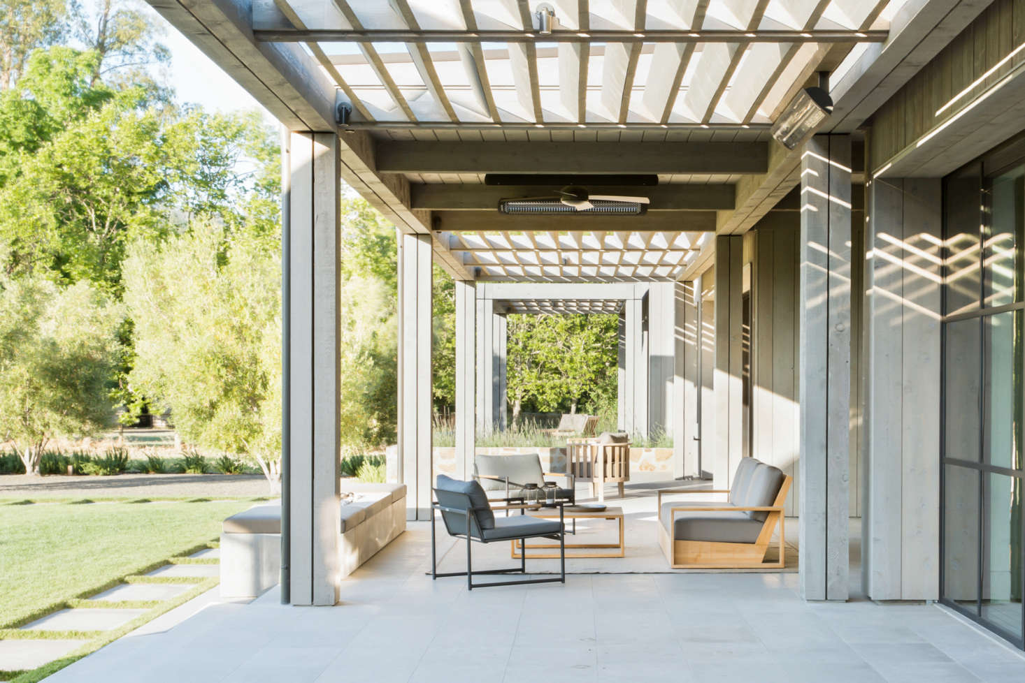 The series of indoor rooms leads directly to outdoor living spaces.
