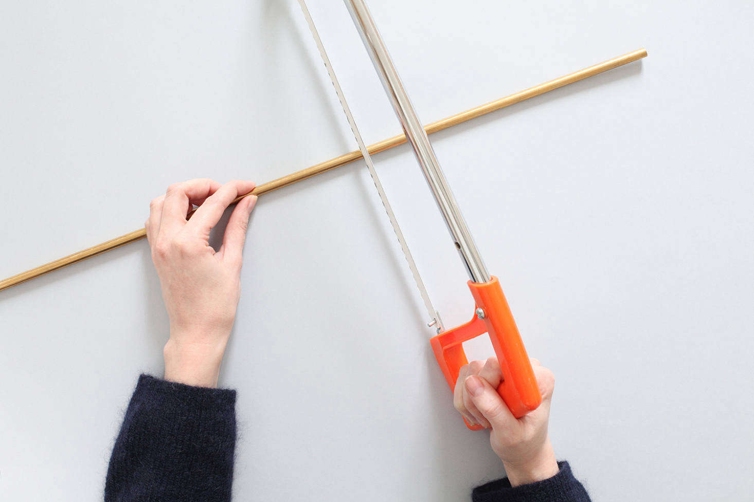 If your supplier won't cut a brass rod to size—53 centimeters long—use a hacksaw and sand the edges.