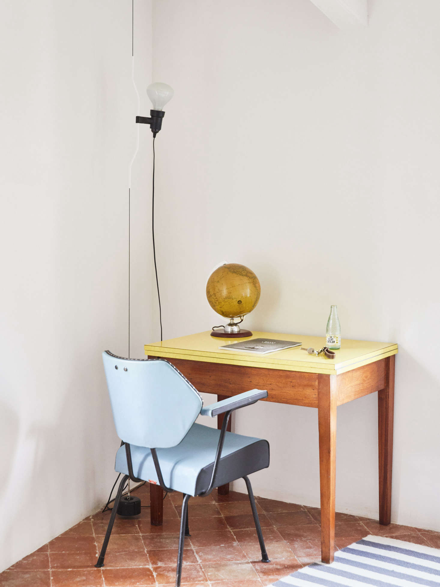 The desk is a vintage 60's piece from Lannion in Brittany, and the chair, too, is vintage, sourced from Amapola Antiques in Madrid. The lamp is the Flos Parentesi Floor Lamp in white.