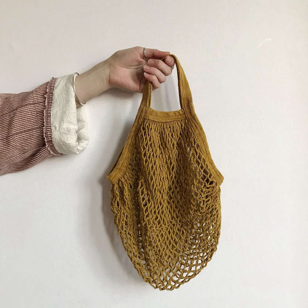 A Mustard Short-Handled String Bag is €20.