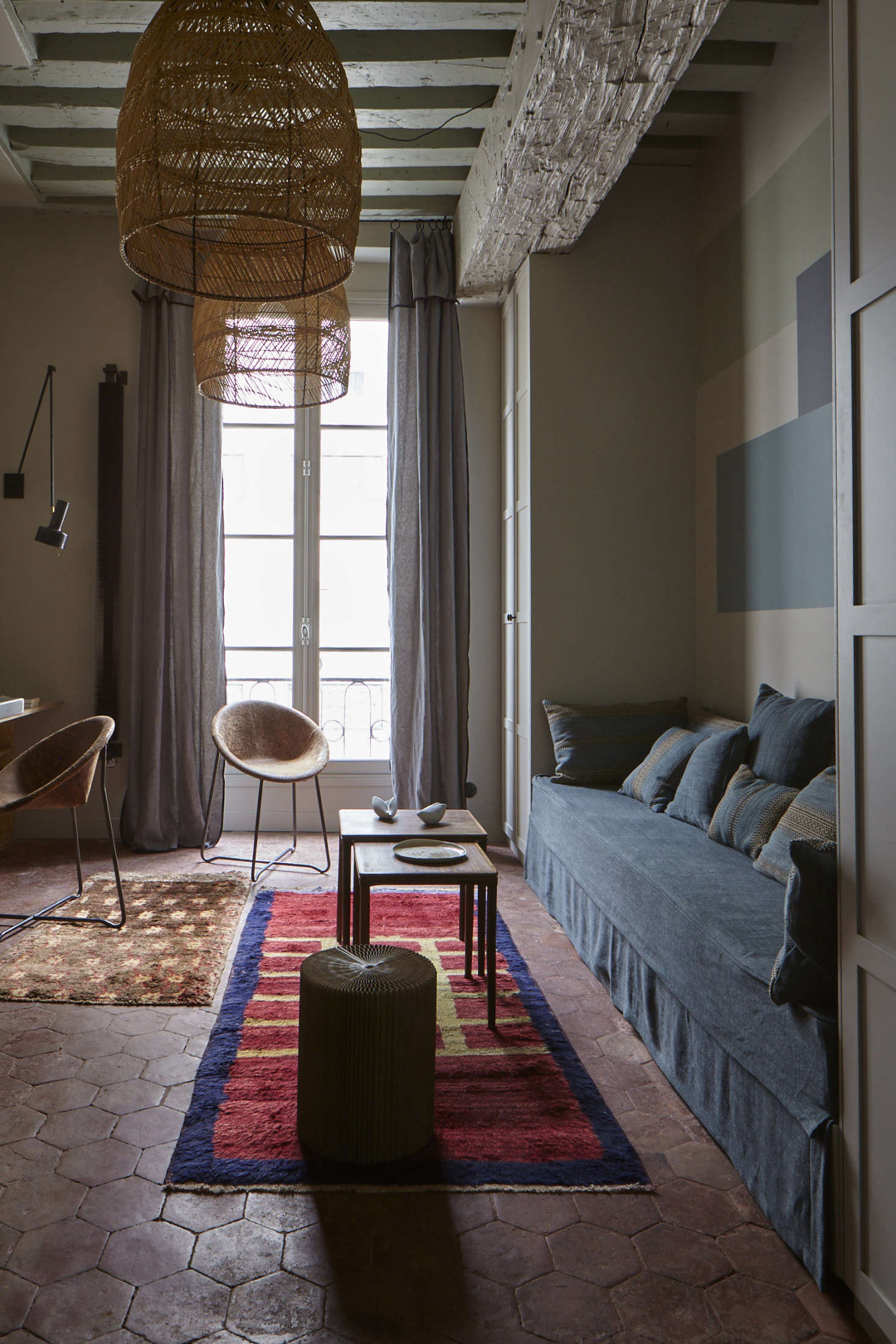 True to style, Evennou worked her color magic, balancing blues with reds and rusts, including the original terra cotta tiles. The rattan pendant lights are from Cinq Étoiles.