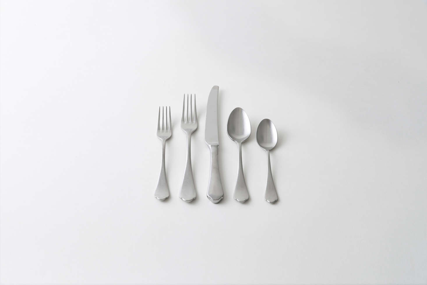 """From Italian brand Mepra, the Dolcevita Flatware in Vintage Pewter has, as retailer March puts it, """"a classic scalloped edge and modern finish."""" Made in Italy, the set is $72 at March."""