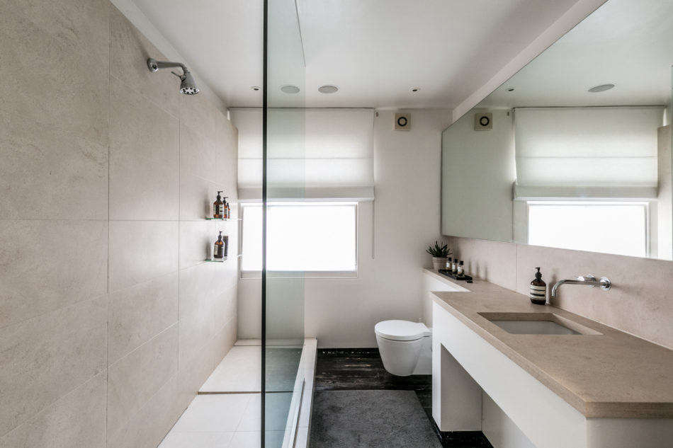 A narrow bathroom on this floor means no room for a soaking tub. Instead, a limestone shower stall lines one wall.