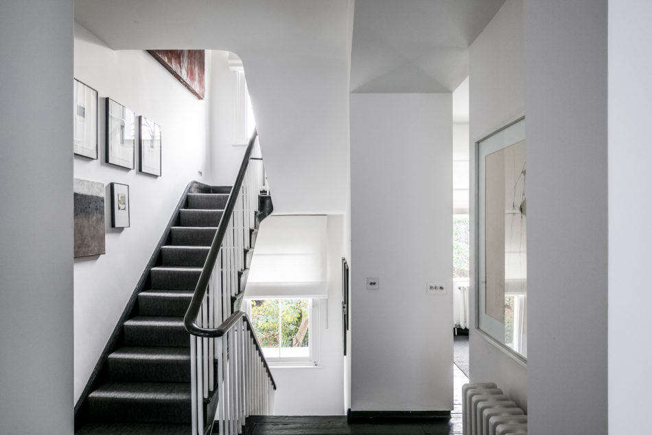 The original balustrade was painted black and white to reflect the home's strict color theme.