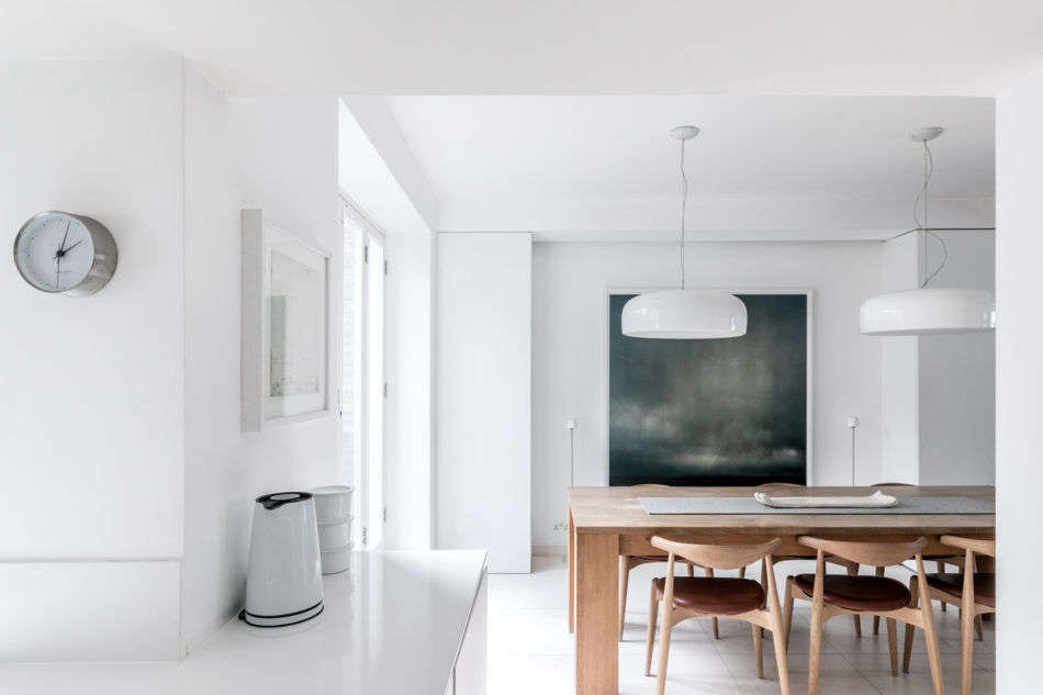 White walls and floors keep this basement floor light and bright.