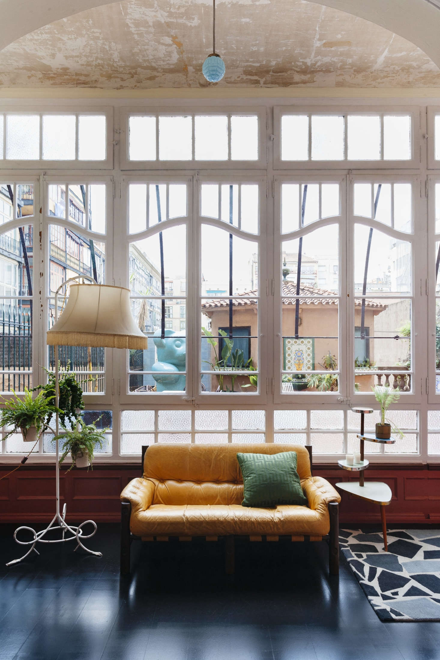 The room overlooks a roof terrace with a tiled pavilion. Just about all of the furnishings are flea market finds.