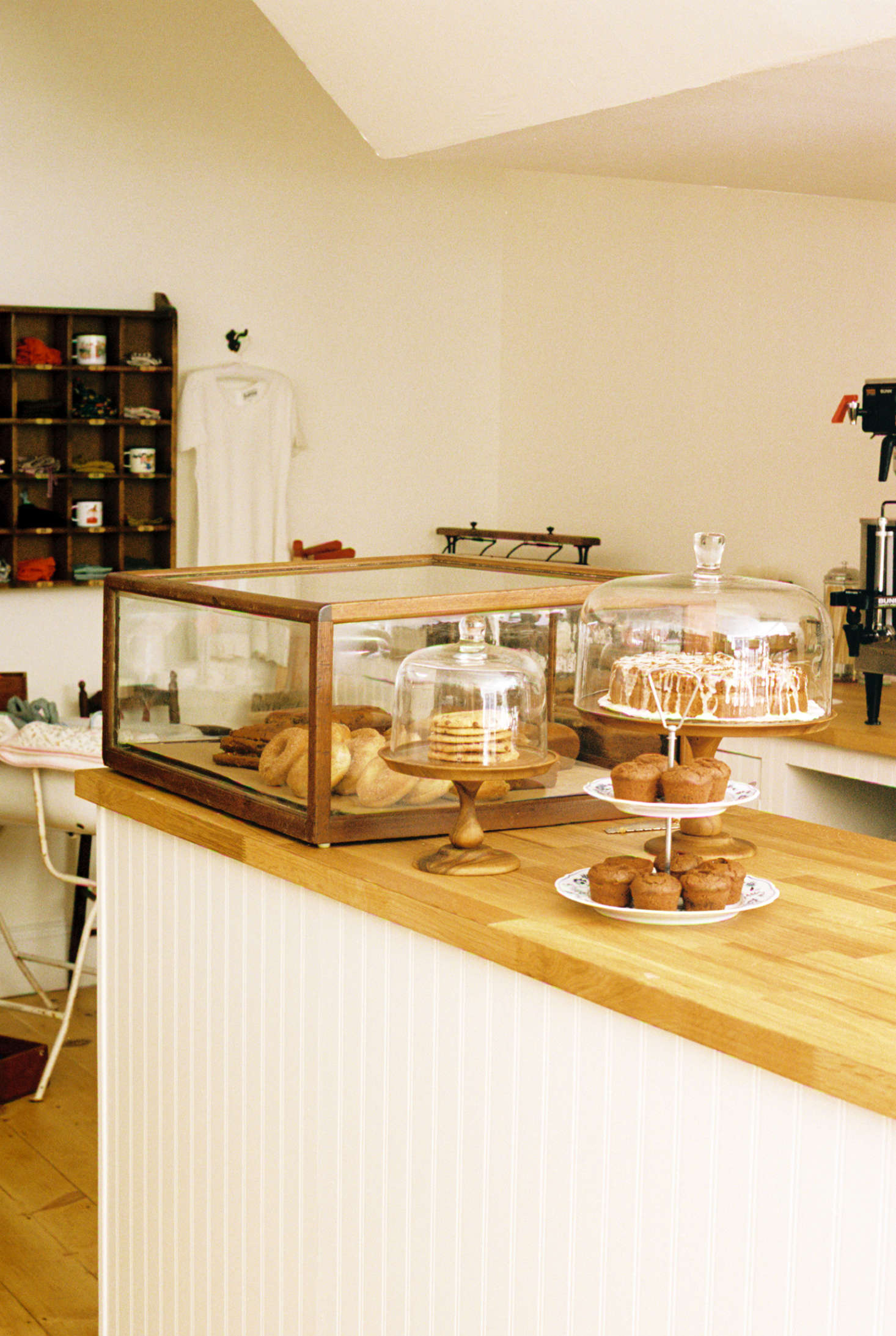 The shop has a small cafe serving tea, coffee, and vegan baked goods, with artists working the espresso machine.
