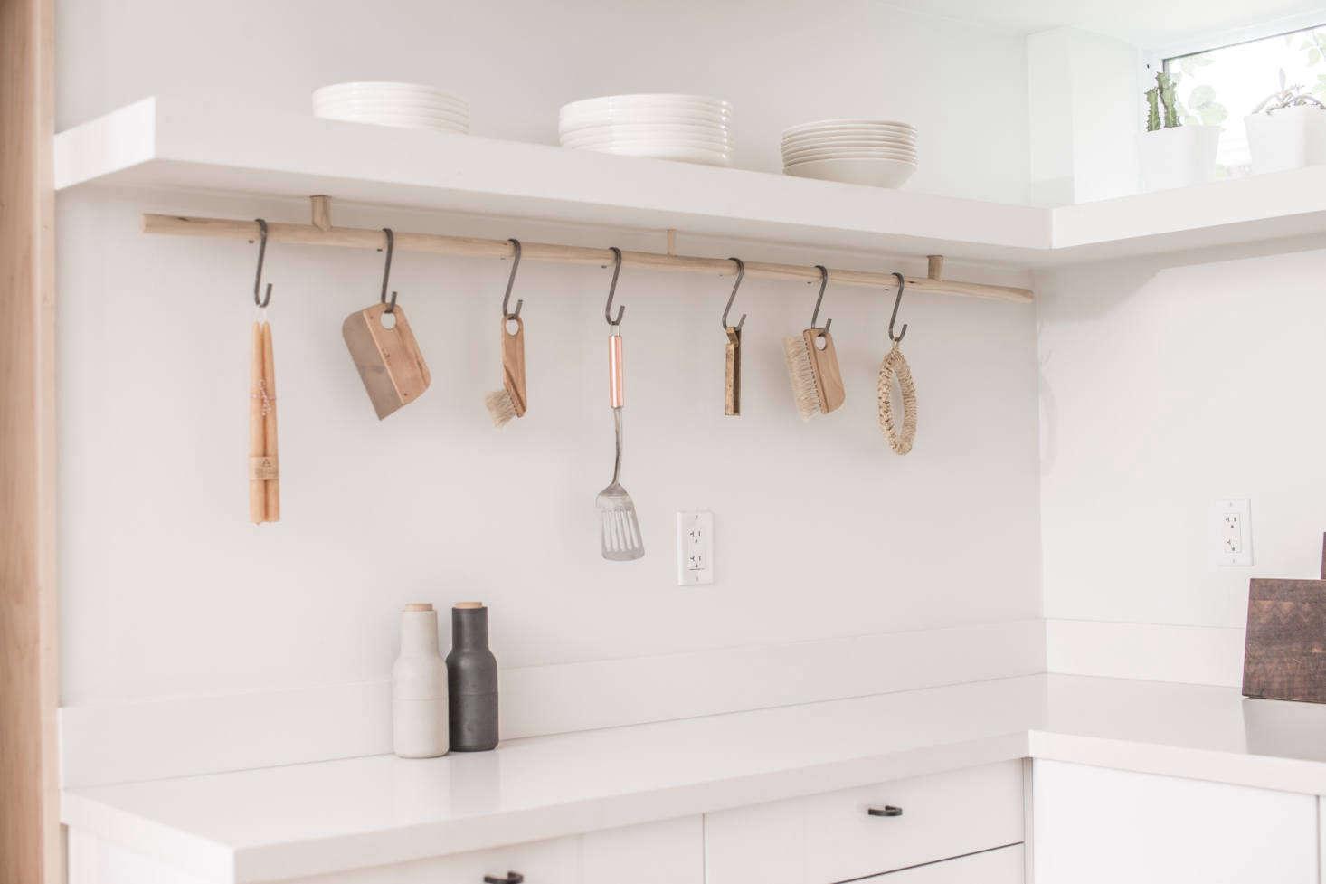 A custom wood rod and S hooks provides hanging storage.