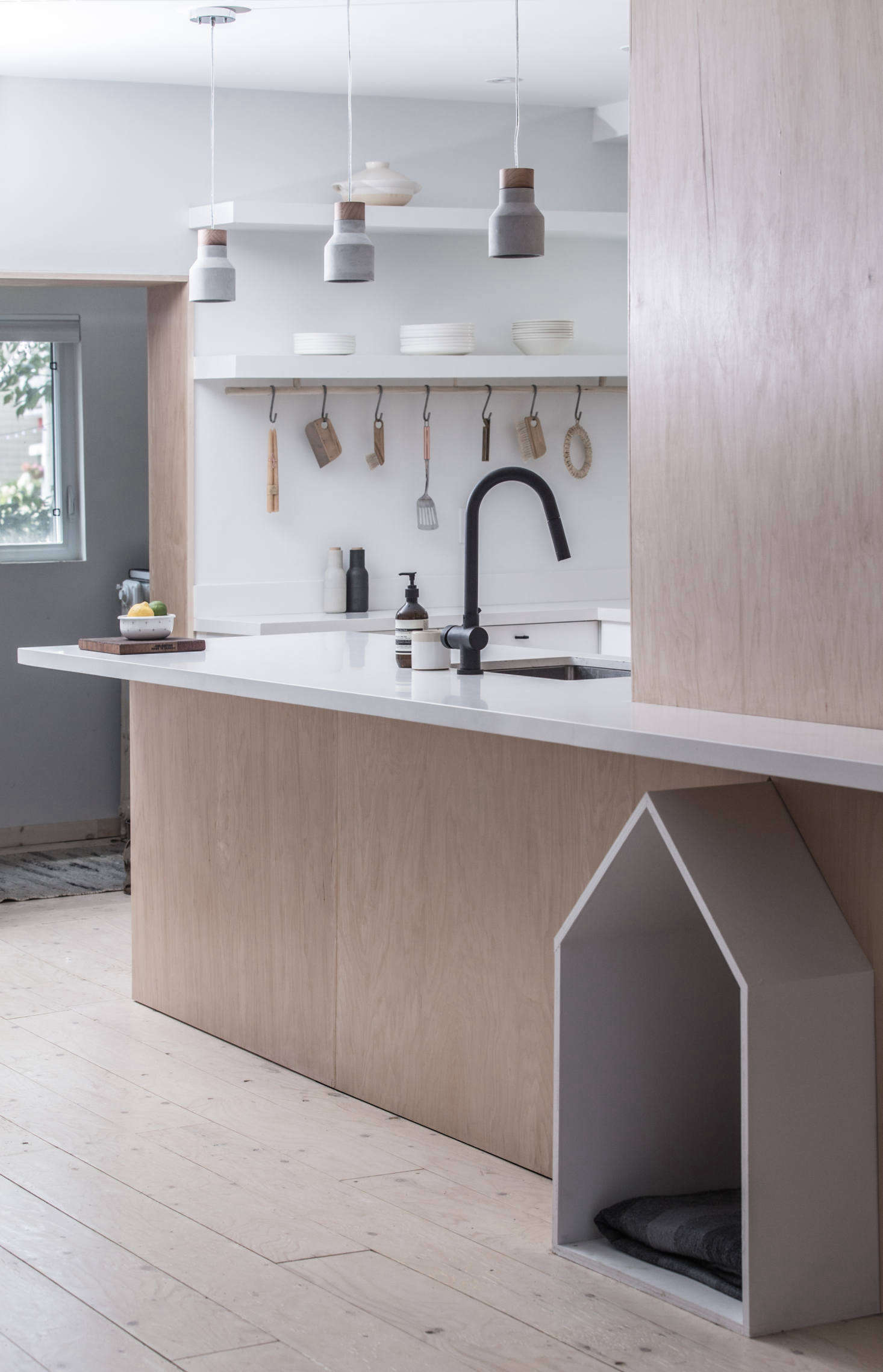 The matte black faucet is Vigo's Gramercy pull-down design; $169.90 from Build.com. The hanging ceramic lights were supplied by the clients; for something similar see 10 Easy Pieces: Terracotta Pendant Lights.