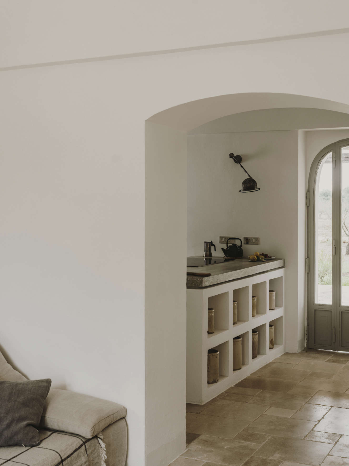 Through an archway into the villa's kitchen.