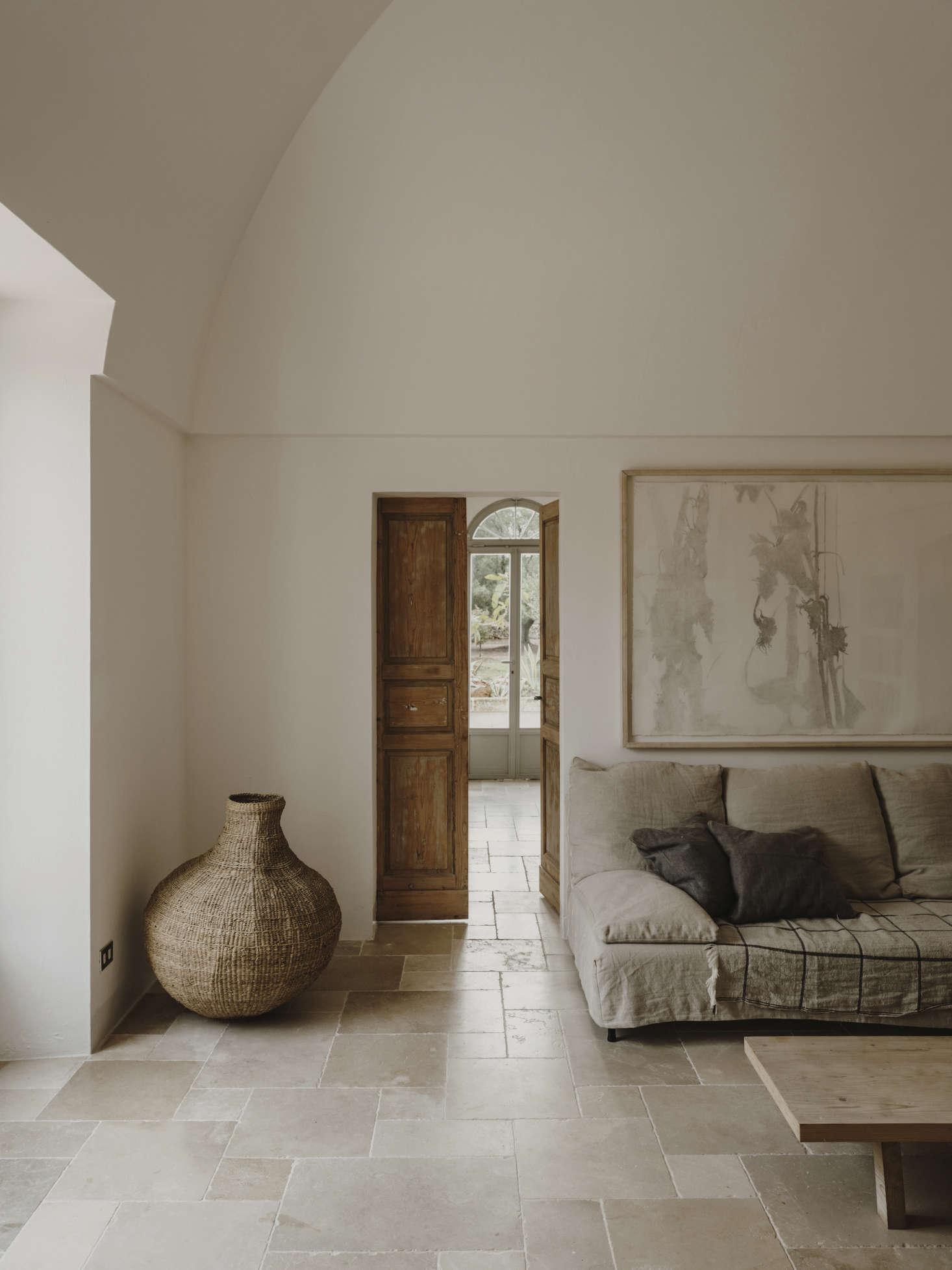 Inside, whitewashed walls meet stone floors and laid-back, linen-covered sofas reminiscent of Trotter's Masseria Moroseta.