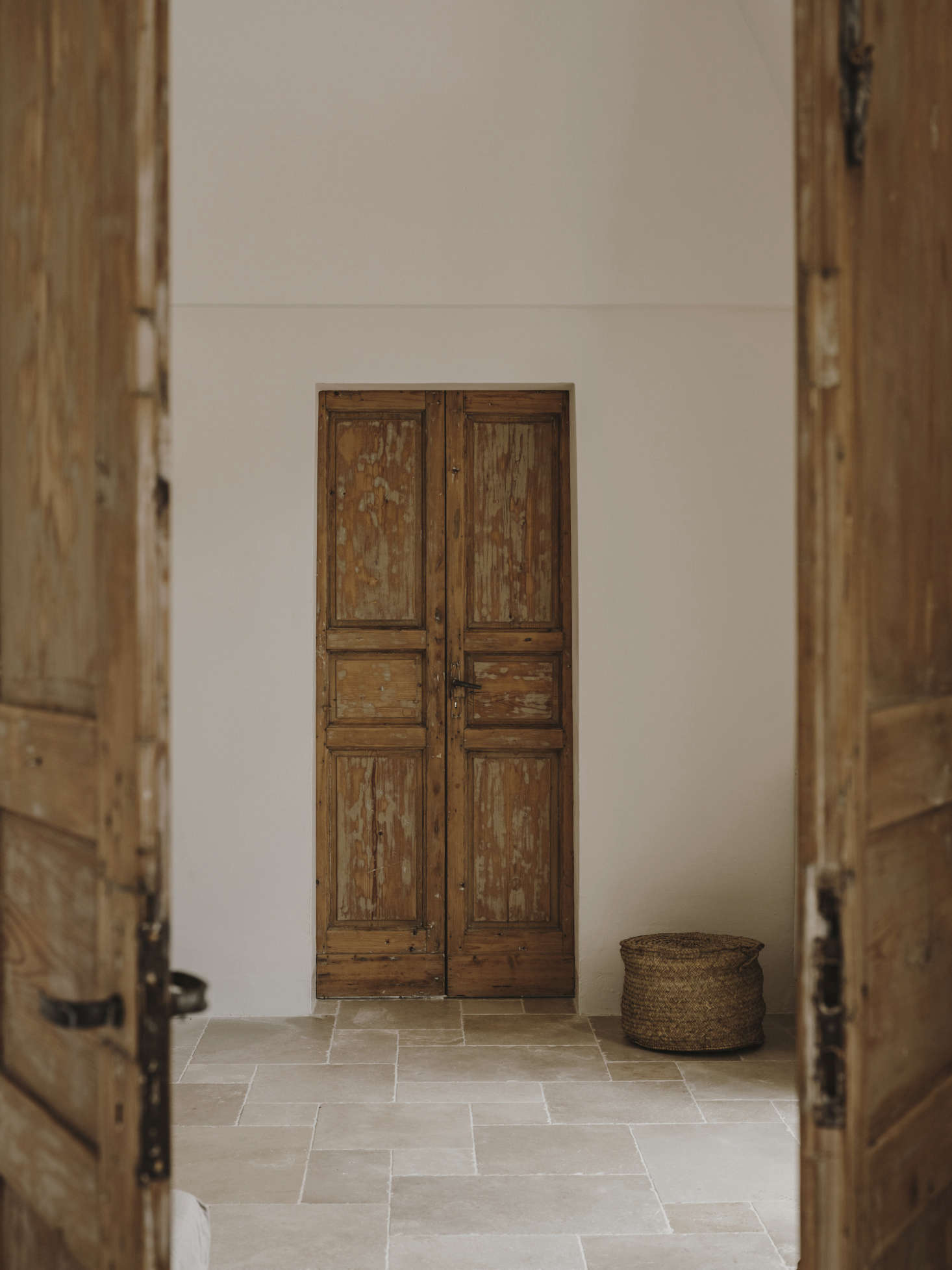 The double wooden doors throughout have plenty of patina.