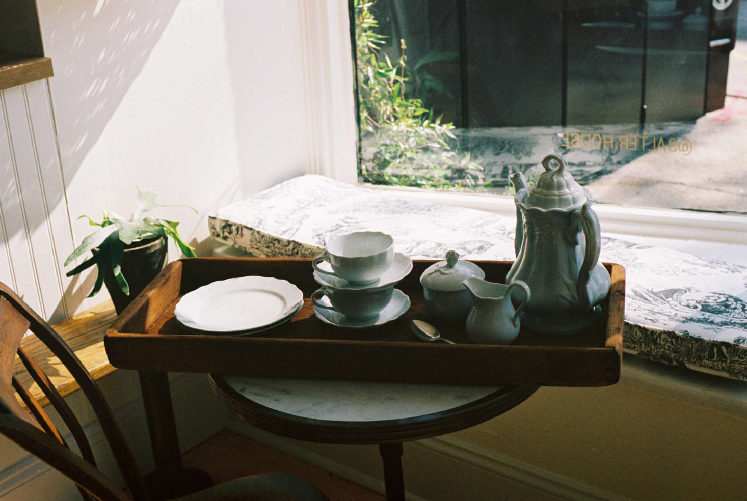 A detail of tea service, served in a sunny window seat. The shop is also entirely plastic free, and visitors will not find any waste baskets.
