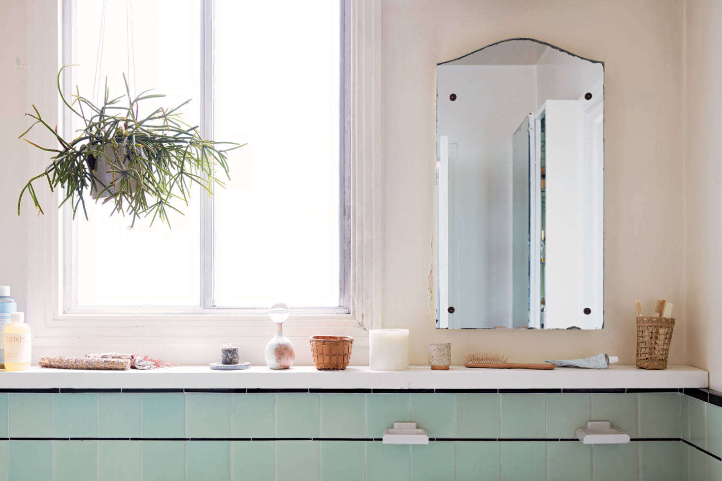 """""""Look for site-specific opportunities,"""" the couple writes: Intheir Great Highway apartment, Mitnik-Miller and St. Peter made use of existing tile by installing a slim piece of framing lumber, painted white, to serve as a simple shelf."""