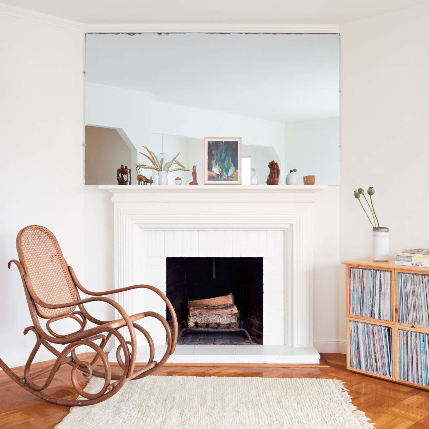 A fireplace is an opportunity for vignettes.