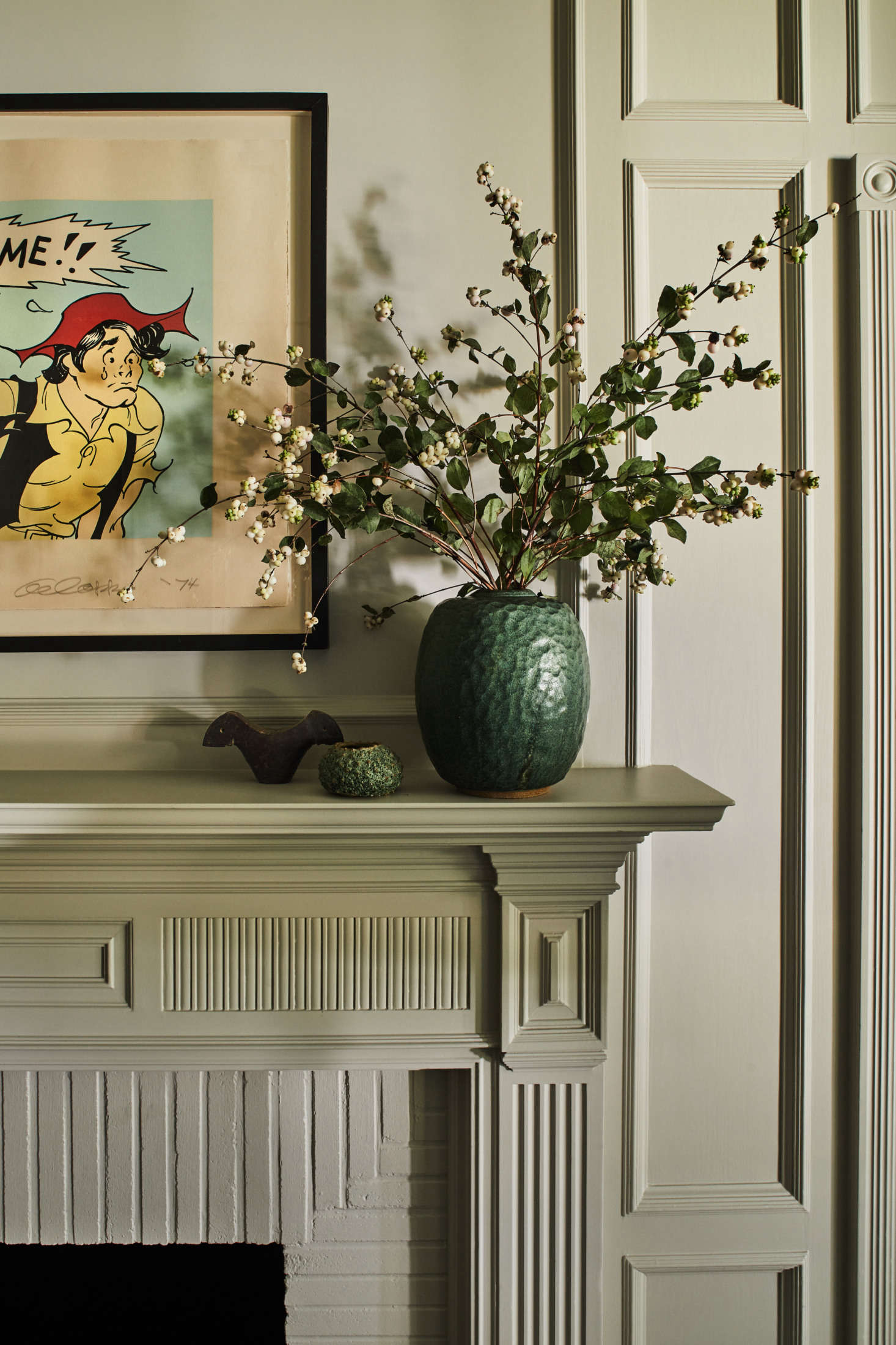 In the den, the original mantel and paneling were updated with fresh paint: satin Collingwood from Benjamin Moore. The Li&#8