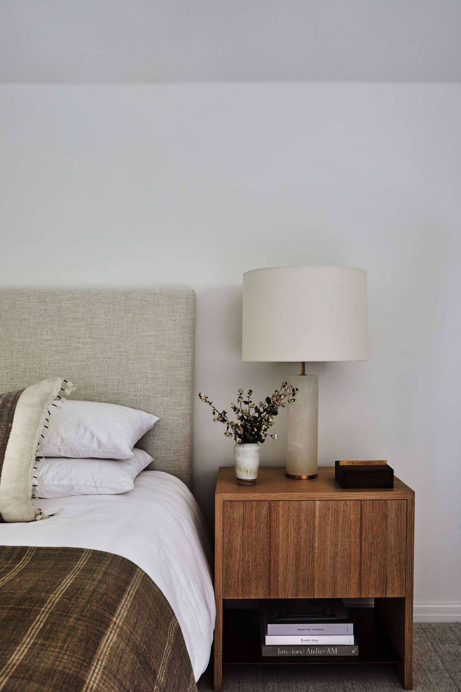"""I know how loud and wild our life is,"" says the mother (with her boys hooting in the background). ""I wanted our bedroom to be completely simple."" The bedside table is DISC's Ito Nightstand, part of a small collection of design staples available from the firm."