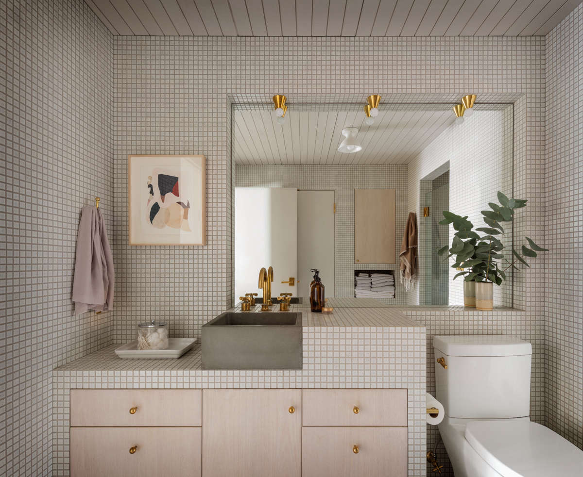 The bathroom is tiled in the same square-inch tile as the kitchen, for cohesiveness, and the sink is also byCement Elegance.