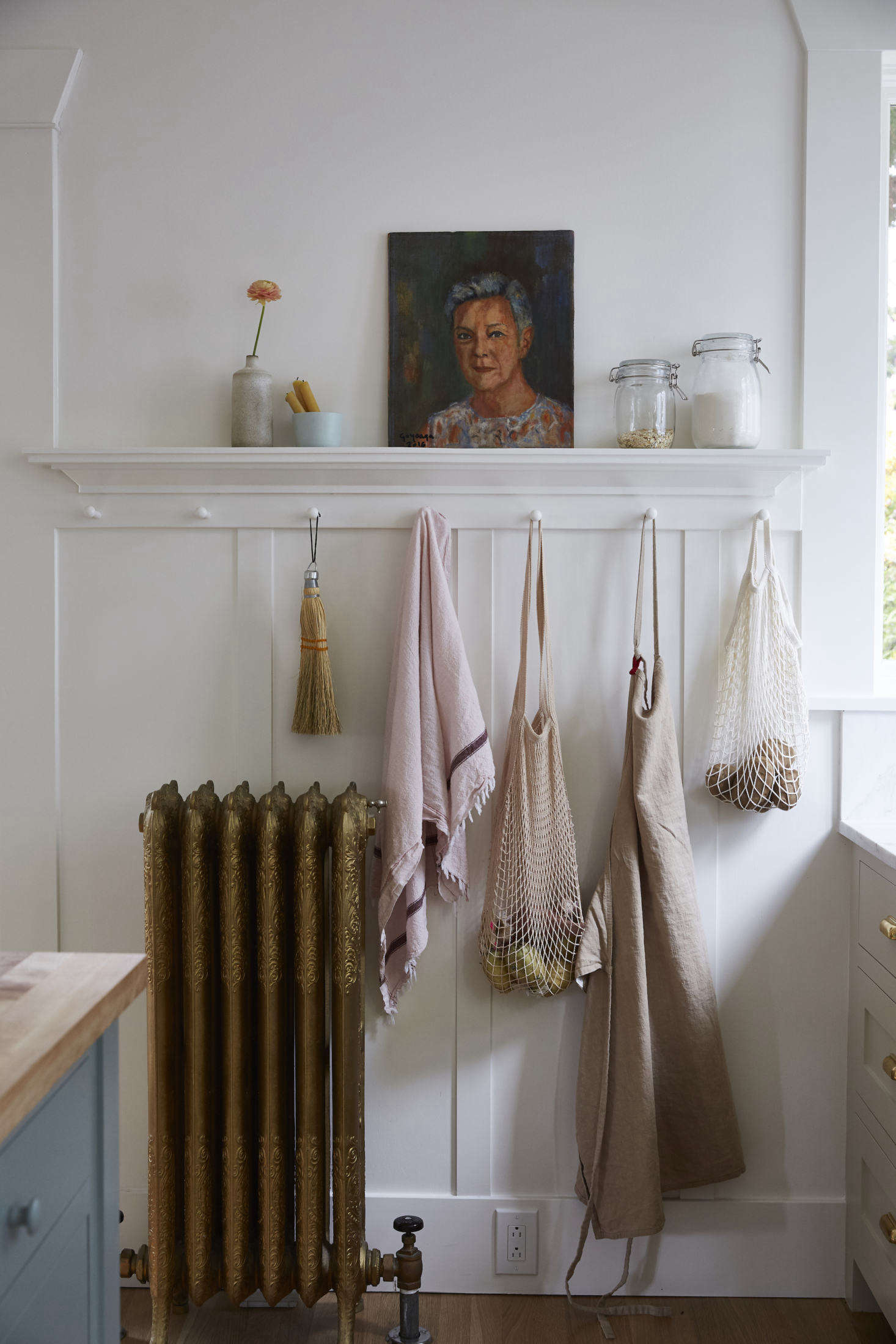 Aran is also a photographer and stylist, as evidenced by this picture-perfect moment in her kitchen. Propped against the wall is a painting, by her dad, of her aunt. &#8
