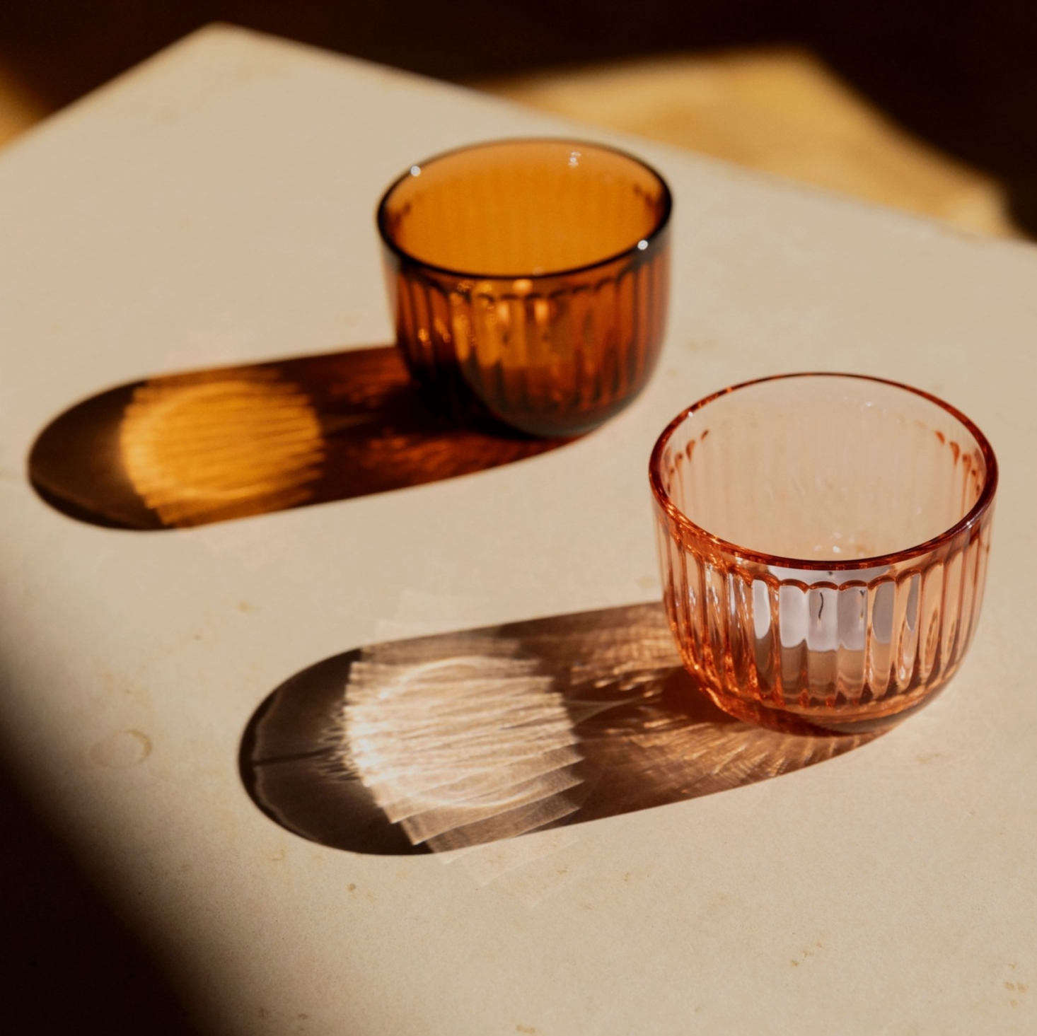 Above Pressed glass: Raami Tea Light Holders in salmon pink are 34.90 for a pair from Iittala.