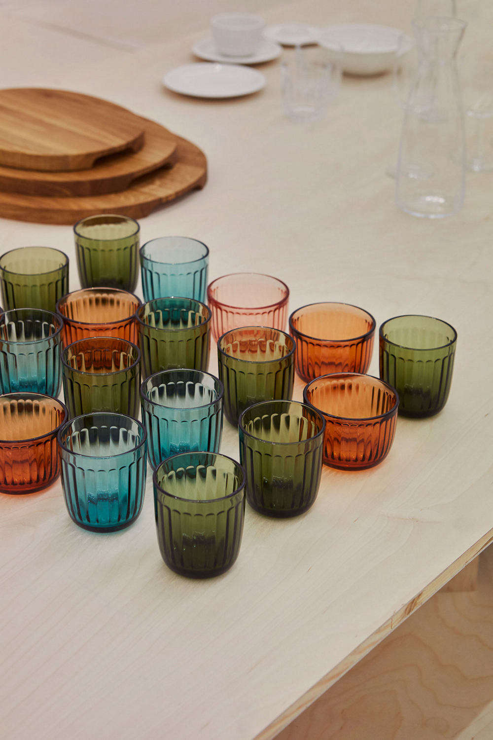 A suite of Raami Tumblers, available in moss green, sea blue, and clear recycled glass, is €