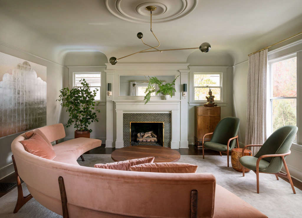 """The curved sofa in the living room was inspired by a Vladimir Kagan design that we then reinterpreted and custom made with the help of Master Furniture Makers and Trio Upholstery,"" says the designer. The Neva lounge chairs are by Artisan and the ceiling light is by Shanghai-based Neri & Hu. On the walls is Benjamin Moore Gray Mirage."