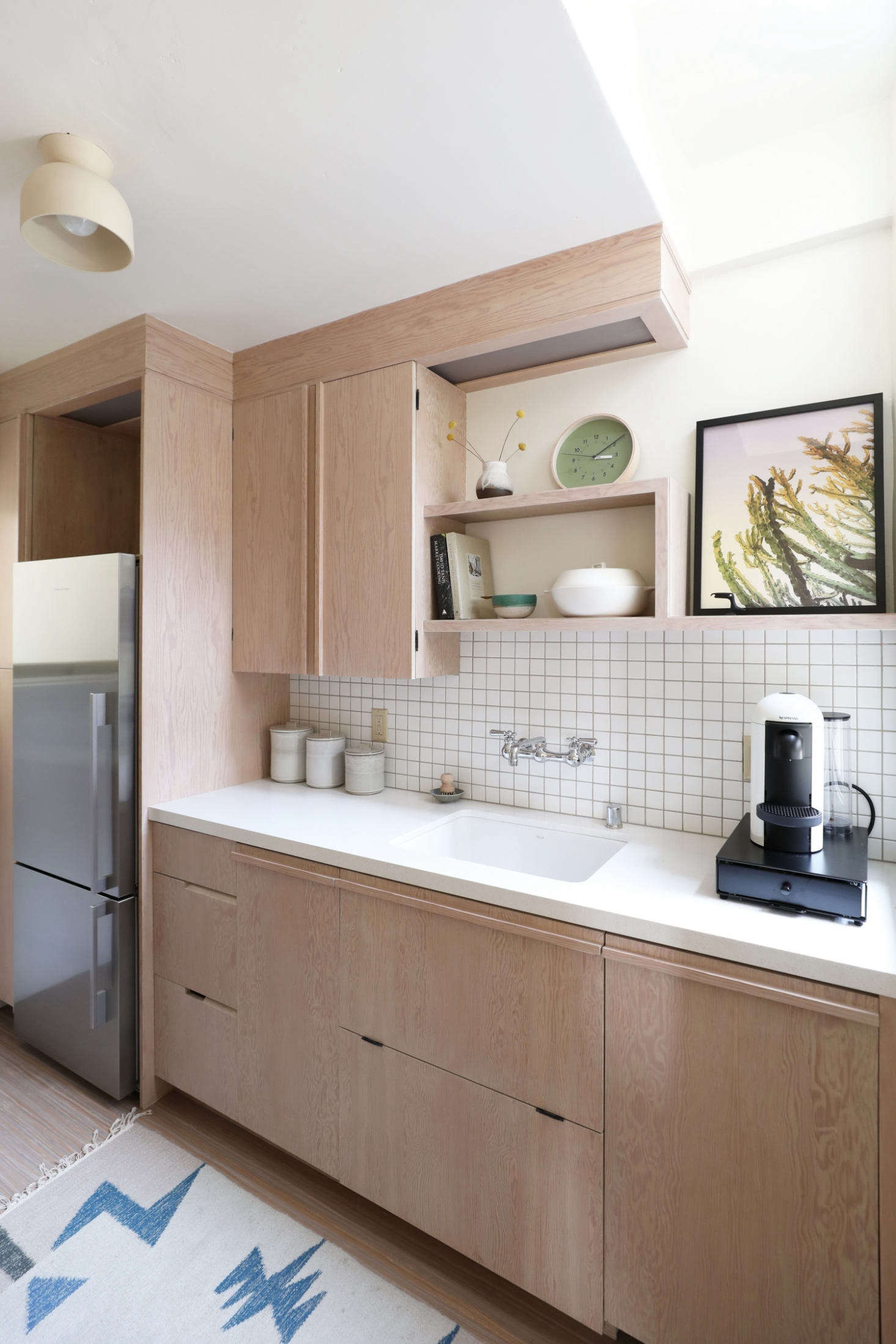 All the cabinetry and built-in shelving throughout the unit were based on designs in the original apartments. (See  Easy Pieces: Wall-Mounted Industrial Faucets for similar faucets.)