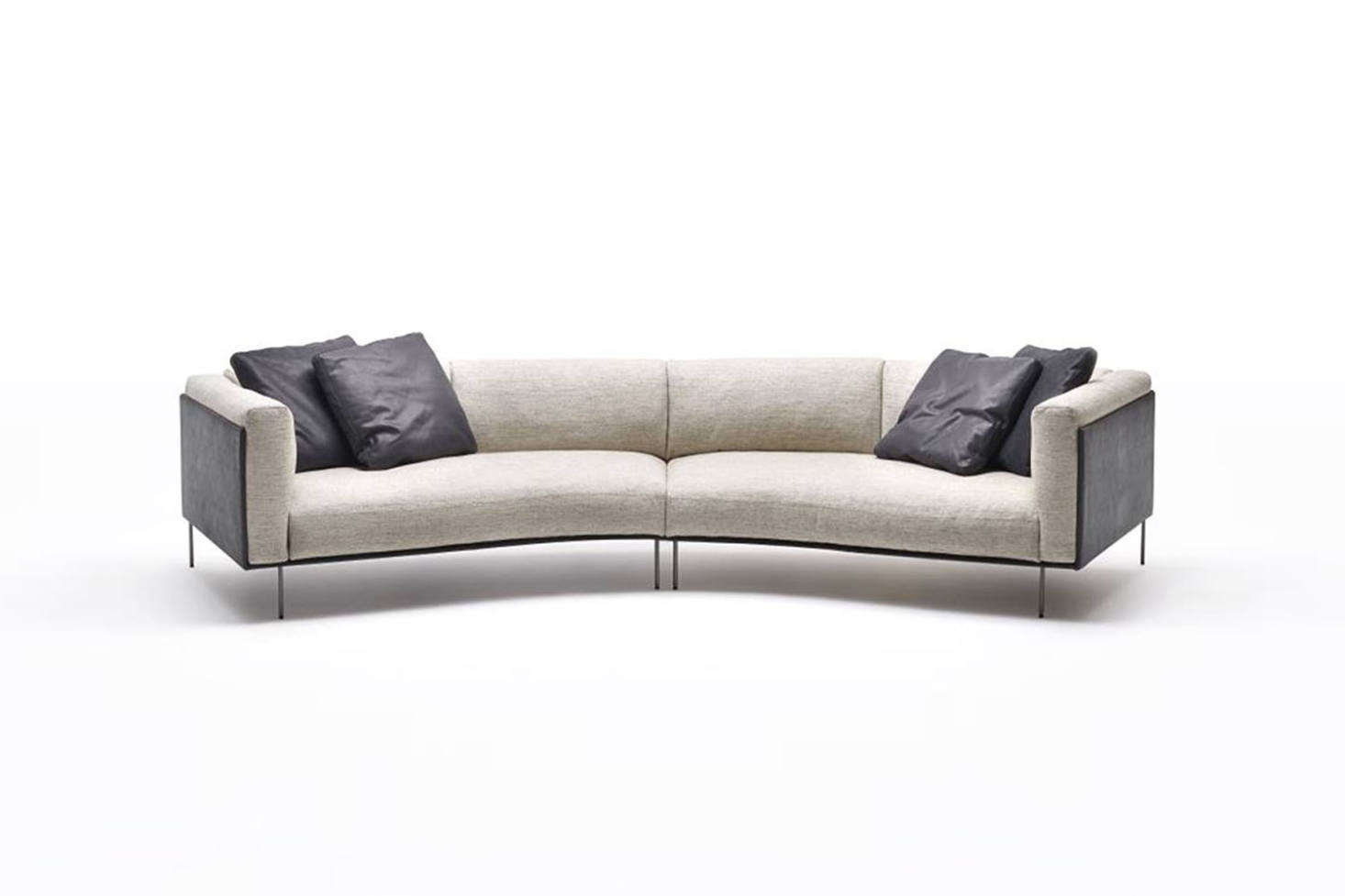 The Piero Lissoni Rod Bean Sofa designed for Living Divani, is a curved style that sits on a minimal frame made of lacquered, drawn tubular steel and stainless steel feet. The sofa is £,954 at TwentyTwentyOne.