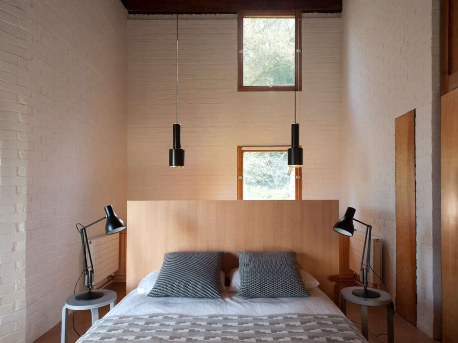 The sleep loft, with a pair of Alvar Aalto stools for nightstands. &#8